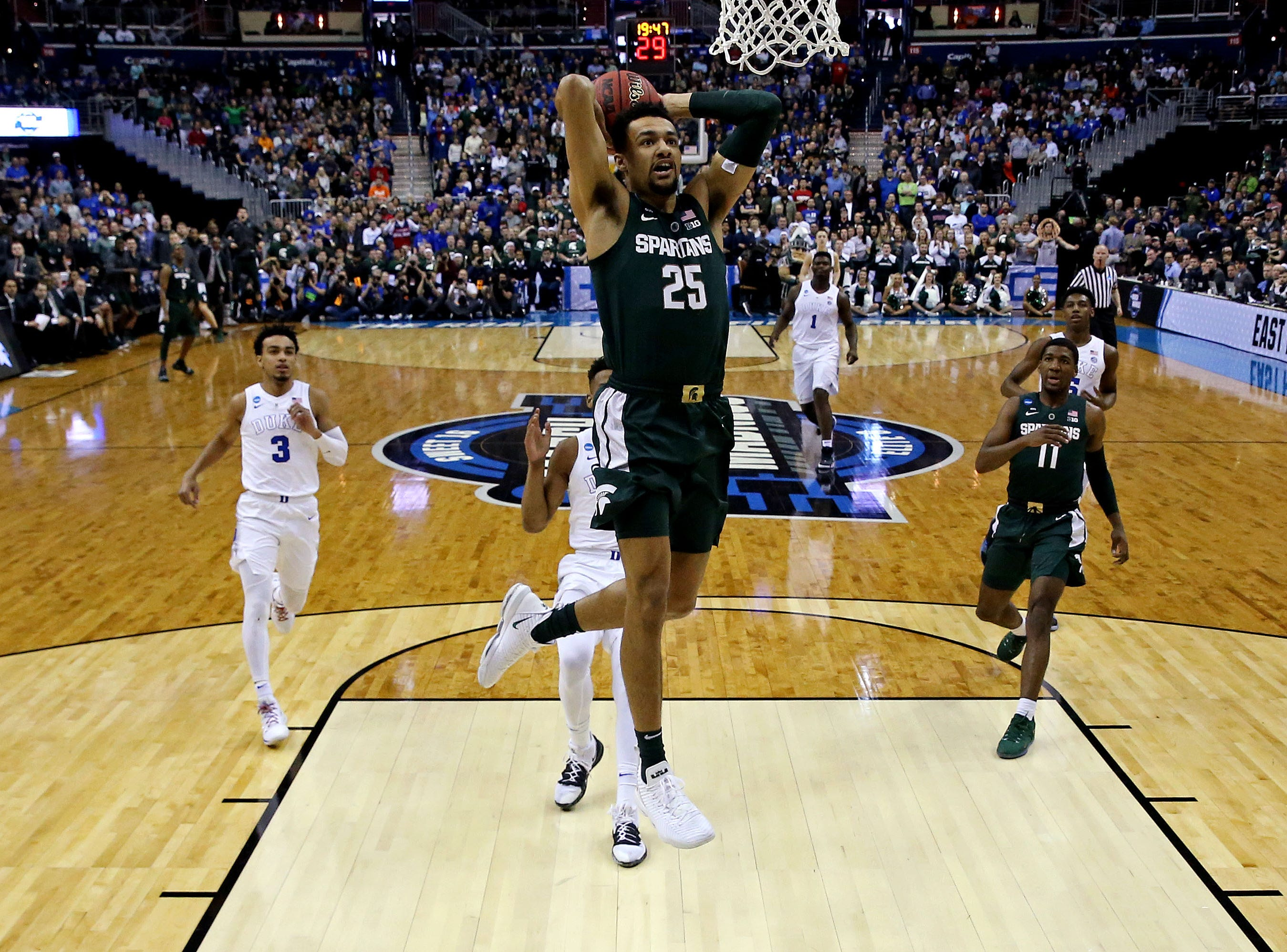 Mar 31, 2019; Washington, DC, USA; Michigan State Spartans forward Kenny Goins (25) dunks the ball during the first half against Duke Blue Devils forward Javin DeLaurier (12) in the championship game of the east regional of the 2019 NCAA Tournament at Capital One Arena. Mandatory Credit: Geoff Burke-USA TODAY Sports