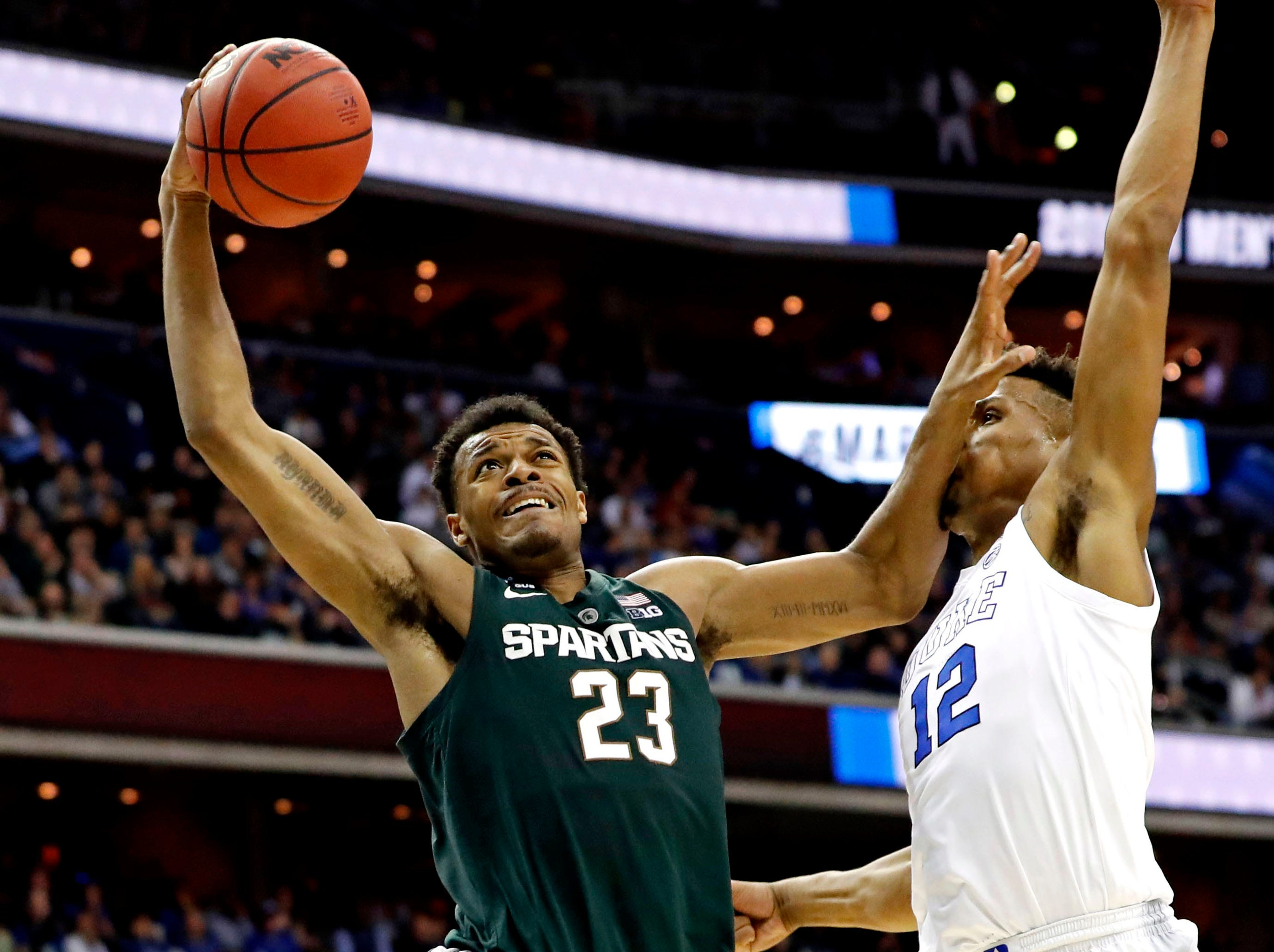 Mar 31, 2019; Washington, DC, USA; Michigan State Spartans forward Xavier Tillman (23) dunks the ball against Duke Blue Devils forward Javin DeLaurier (12) during the second half in the championship game of the east regional of the 2019 NCAA Tournament at Capital One Arena. Mandatory Credit: Geoff Burke-USA TODAY Sports