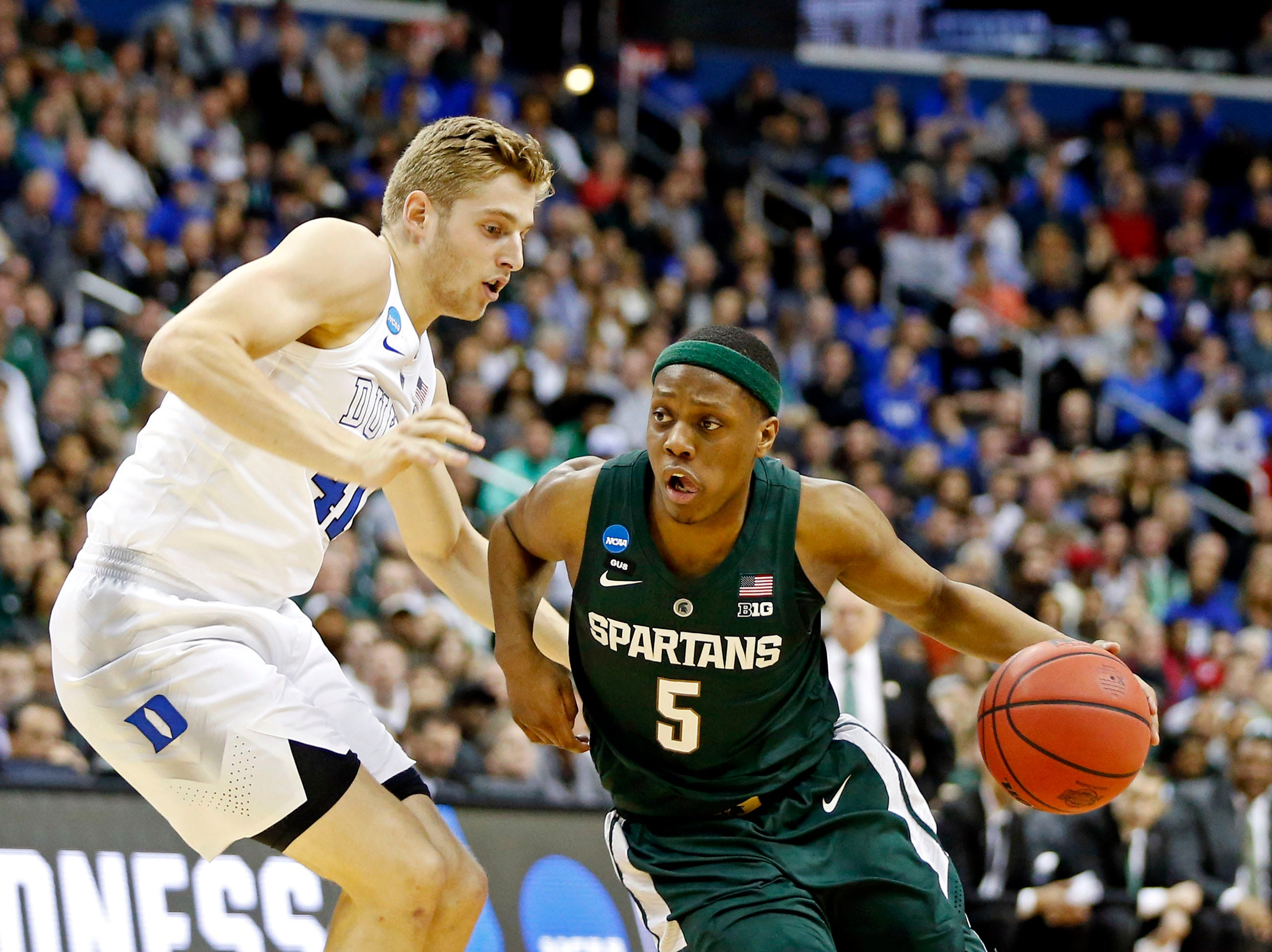 Mar 31, 2019; Washington, DC, USA; Michigan State Spartans guard Cassius Winston (5) drives to the basket against Duke Blue Devils forward Jack White (41) during the first half in the championship game of the east regional of the 2019 NCAA Tournament at Capital One Arena. Mandatory Credit: Amber Searls-USA TODAY Sports