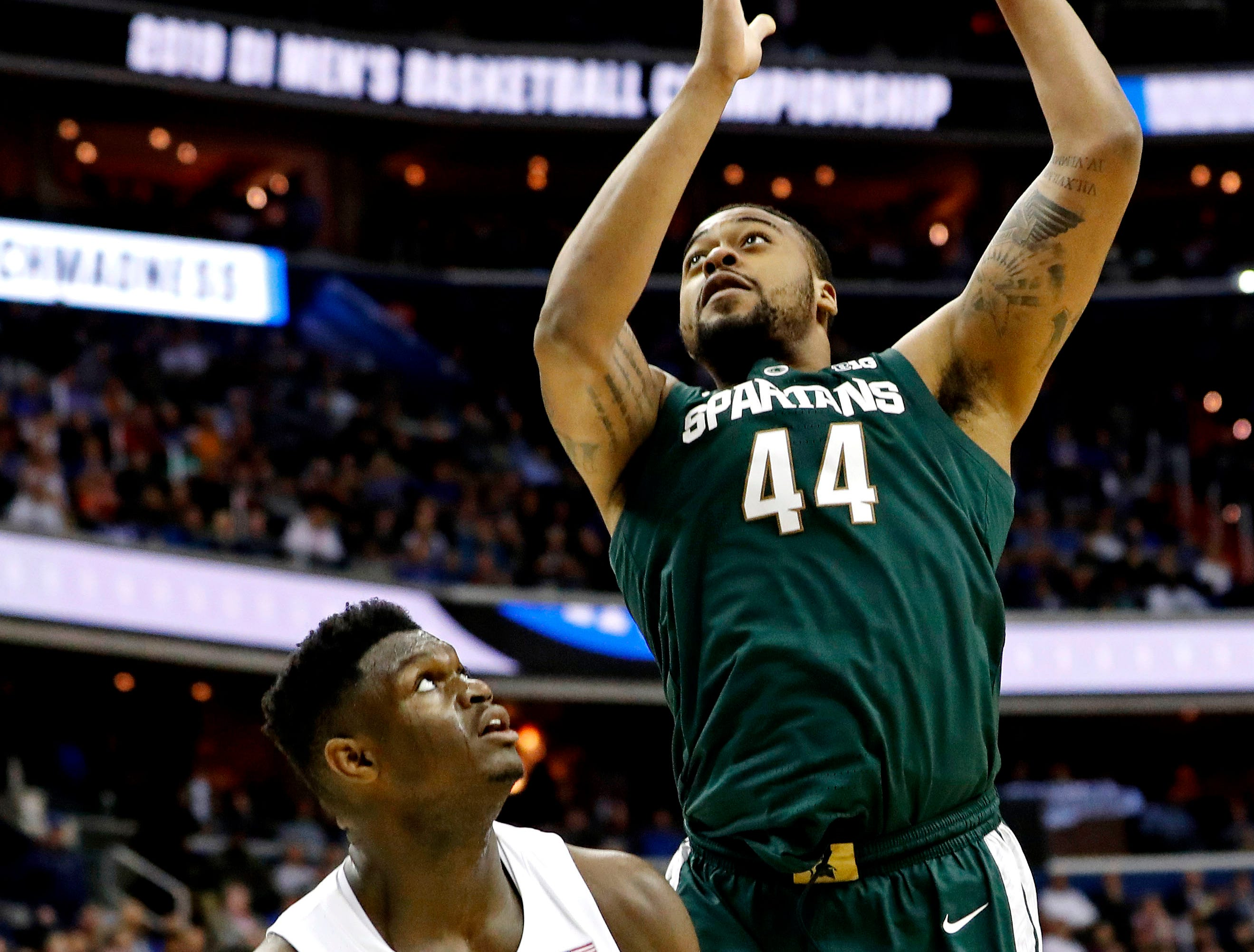 Mar 31, 2019; Washington, DC, USA; Michigan State Spartans forward Nick Ward (44) shoots the ball against Duke Blue Devils forward Zion Williamson (1) during the second half in the championship game of the east regional of the 2019 NCAA Tournament at Capital One Arena. Mandatory Credit: Geoff Burke-USA TODAY Sports