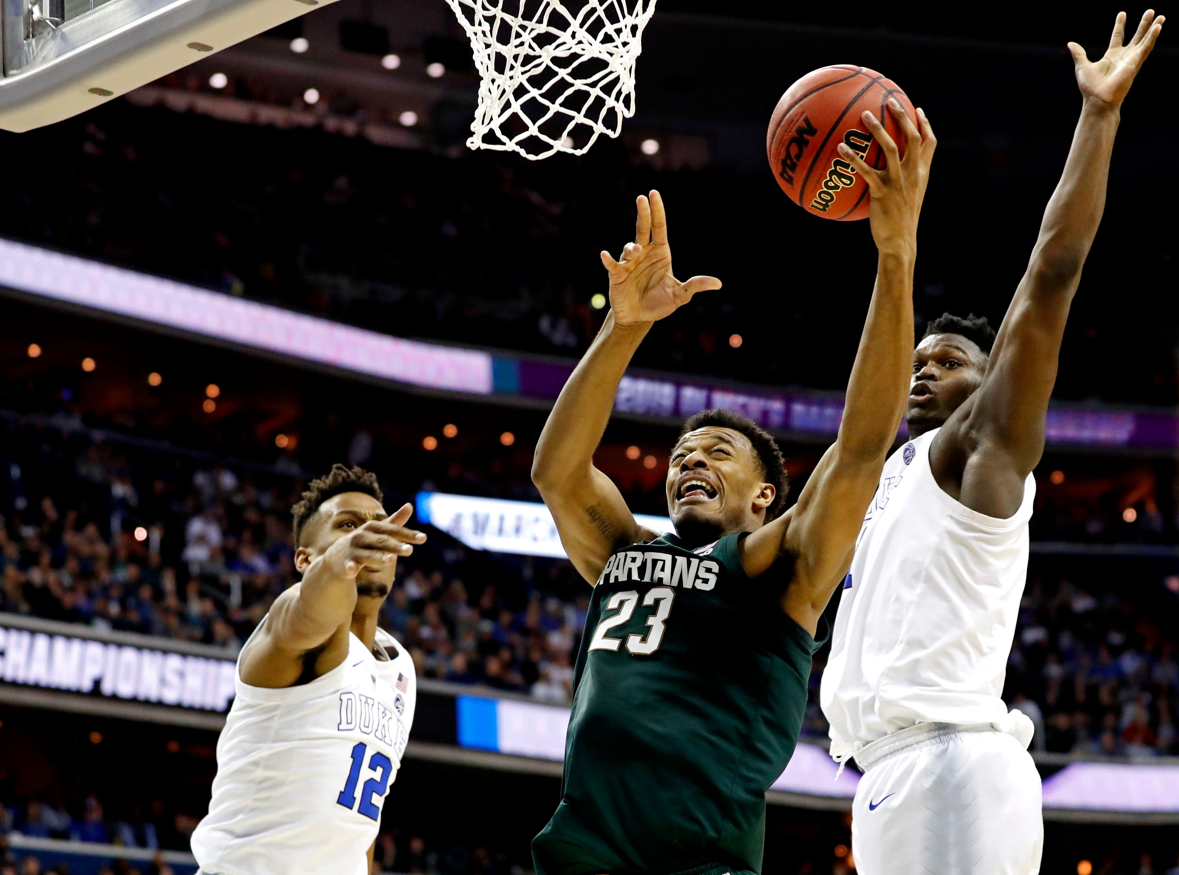 Mar 31, 2019; Washington, DC, USA; Michigan State Spartans forward Xavier Tillman (23) shoots the ball against Duke Blue Devils forward Zion Williamson (1) during the second half in the championship game of the east regional of the 2019 NCAA Tournament at Capital One Arena. Mandatory Credit: Geoff Burke-USA TODAY Sports