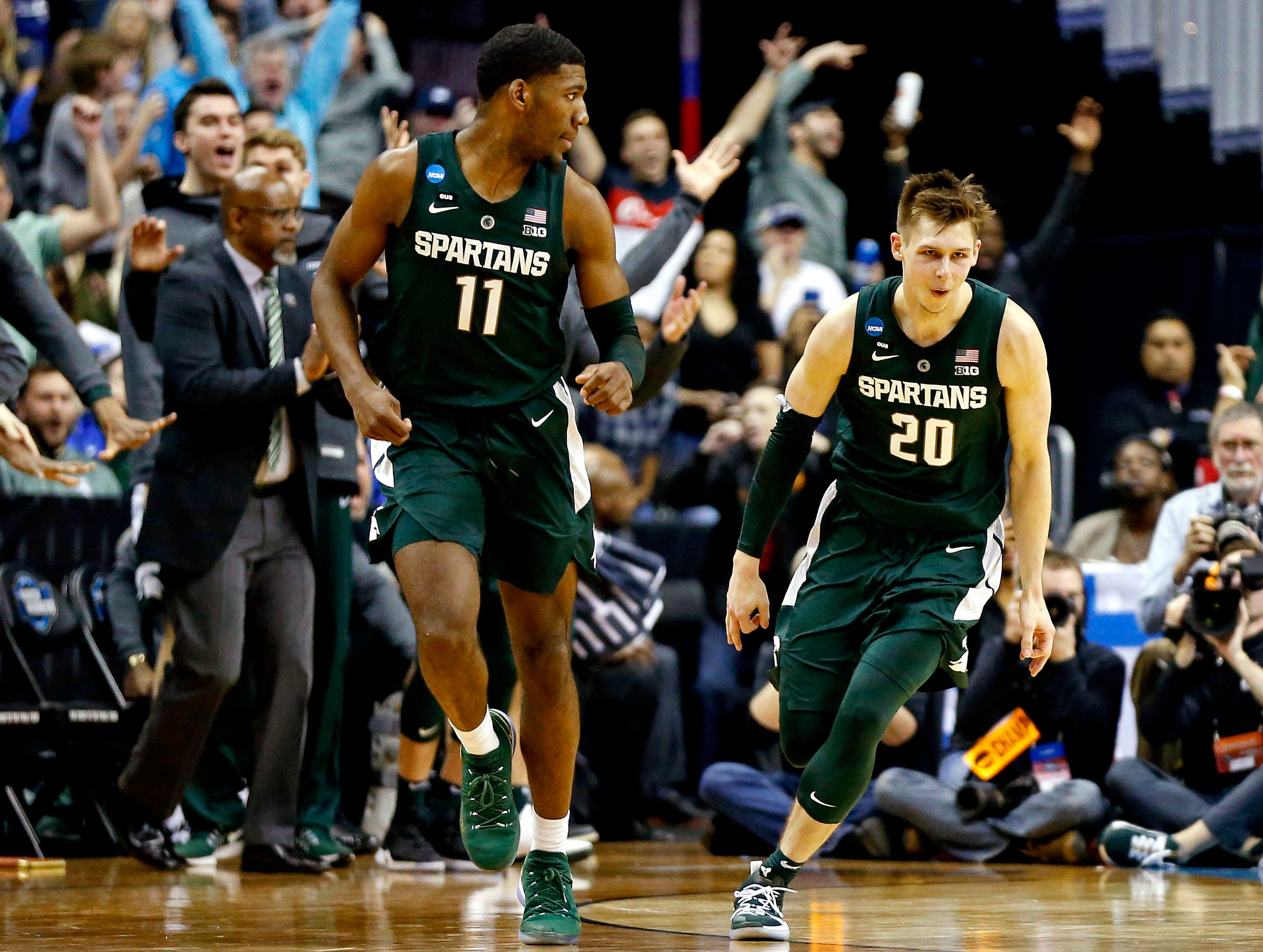 Mar 31, 2019; Washington, DC, USA; Michigan State Spartans guard Matt McQuaid (20) reacts after a play during the second half against the Duke Blue Devils in the championship game of the east regional of the 2019 NCAA Tournament at Capital One Arena. Mandatory Credit: Amber Searls-USA TODAY Sports