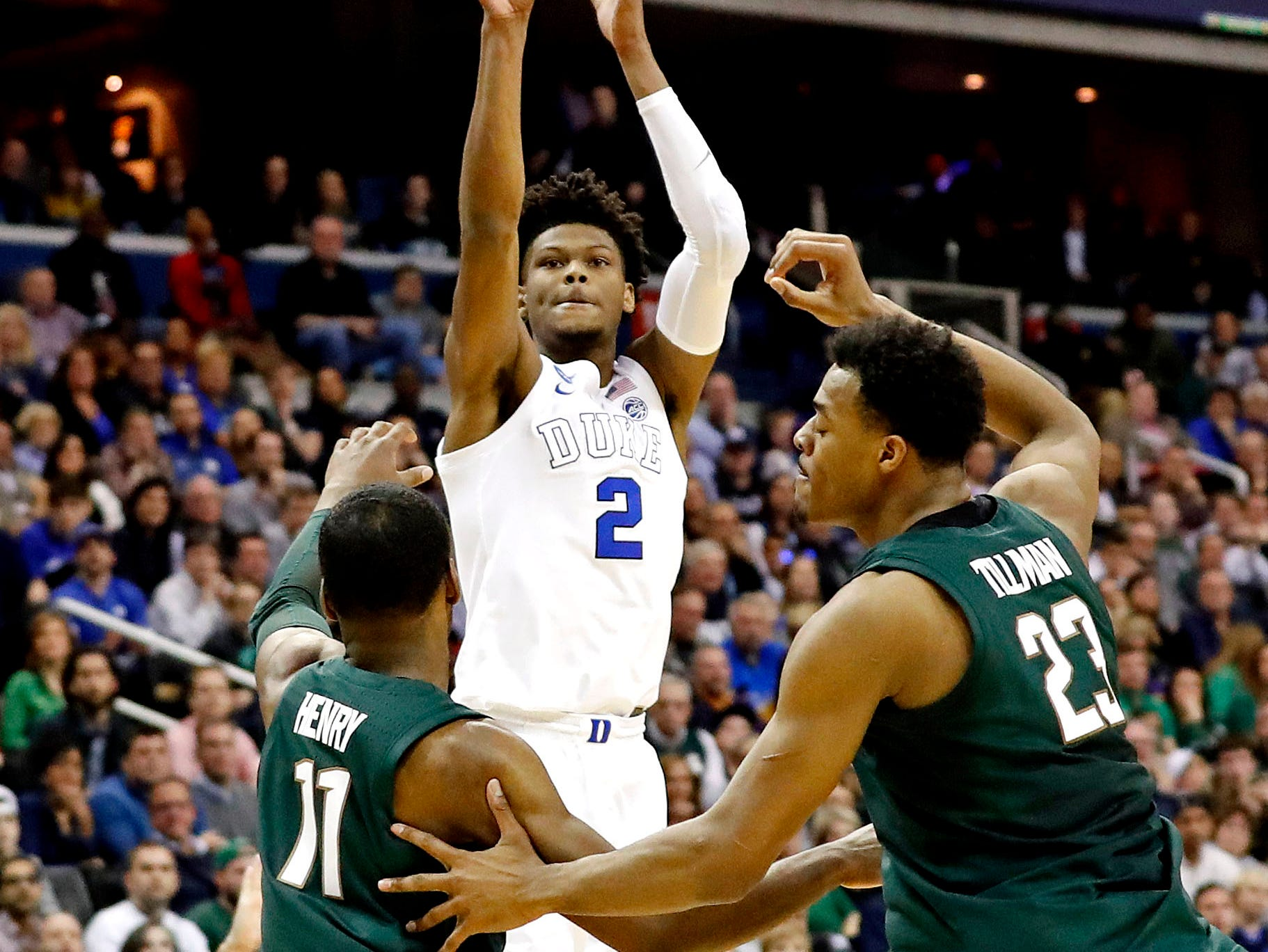 Mar 31, 2019; Washington, DC, USA; Duke Blue Devils forward Cam Reddish (2) shoots the ball against Michigan State Spartans forward Aaron Henry (11) and forward Xavier Tillman (23) during the first half in the championship game of the east regional of the 2019 NCAA Tournament at Capital One Arena. Mandatory Credit: Geoff Burke-USA TODAY Sports