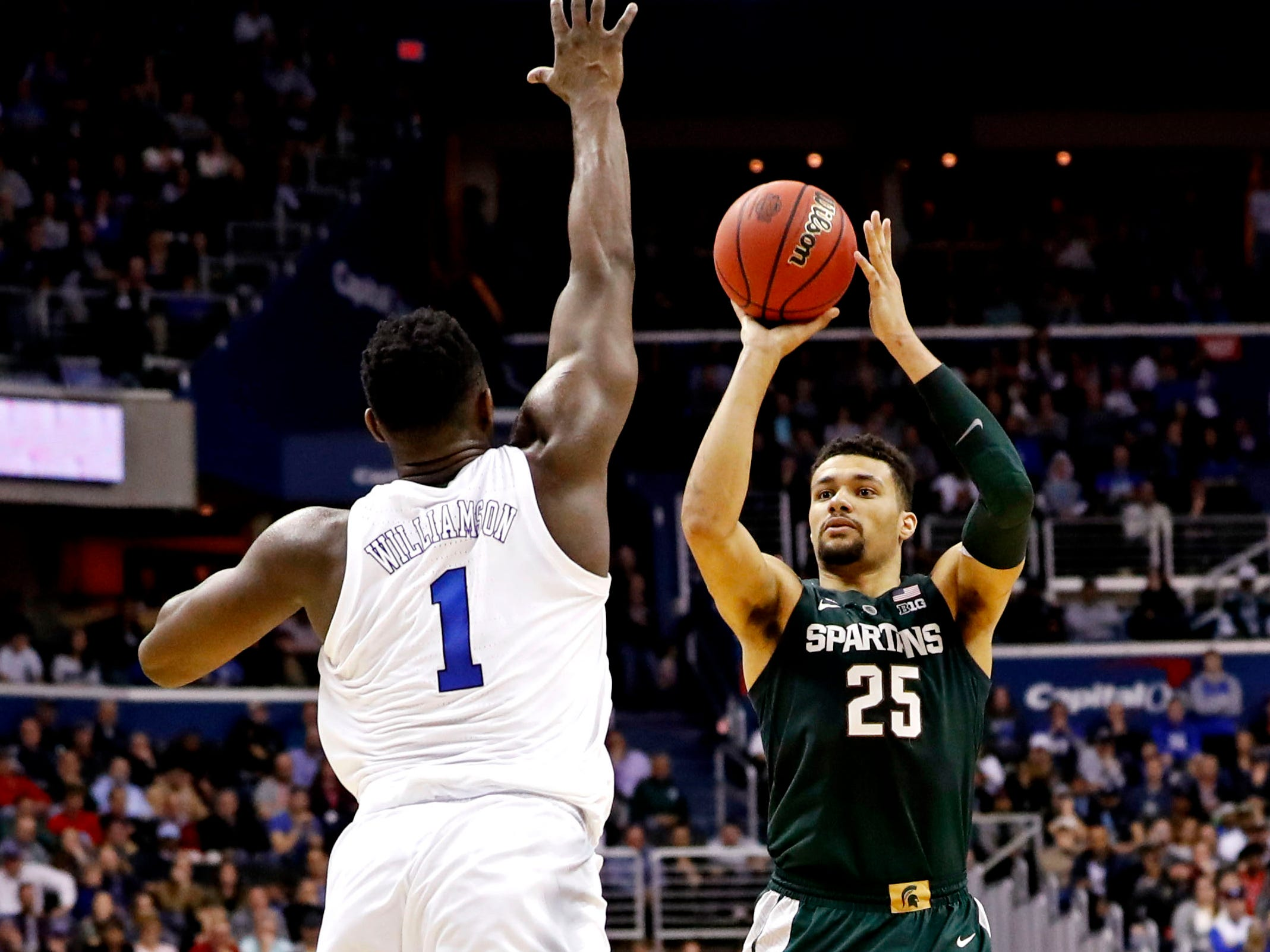 Mar 31, 2019; Washington, DC, USA; Michigan State Spartans forward Kenny Goins (25) shoots the ball against Duke Blue Devils forward Zion Williamson (1) during the second half in the championship game of the east regional of the 2019 NCAA Tournament at Capital One Arena. Mandatory Credit: Geoff Burke-USA TODAY Sports
