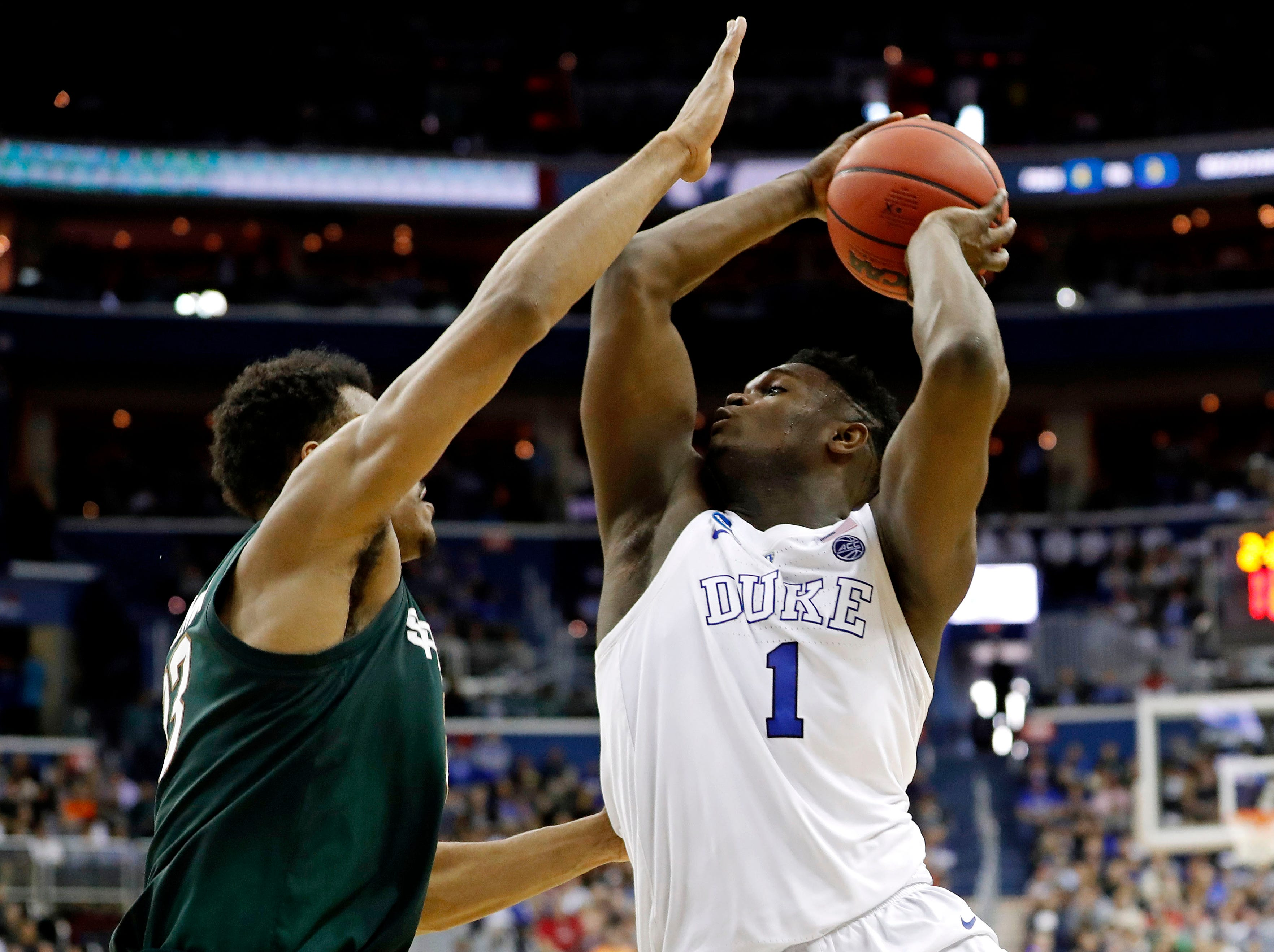 Mar 31, 2019; Washington, DC, USA; Duke Blue Devils forward Zion Williamson (1) drives to the basket against Michigan State Spartans forward Xavier Tillman (23) during the first half in the championship game of the east regional of the 2019 NCAA Tournament at Capital One Arena. Mandatory Credit: Geoff Burke-USA TODAY Sports