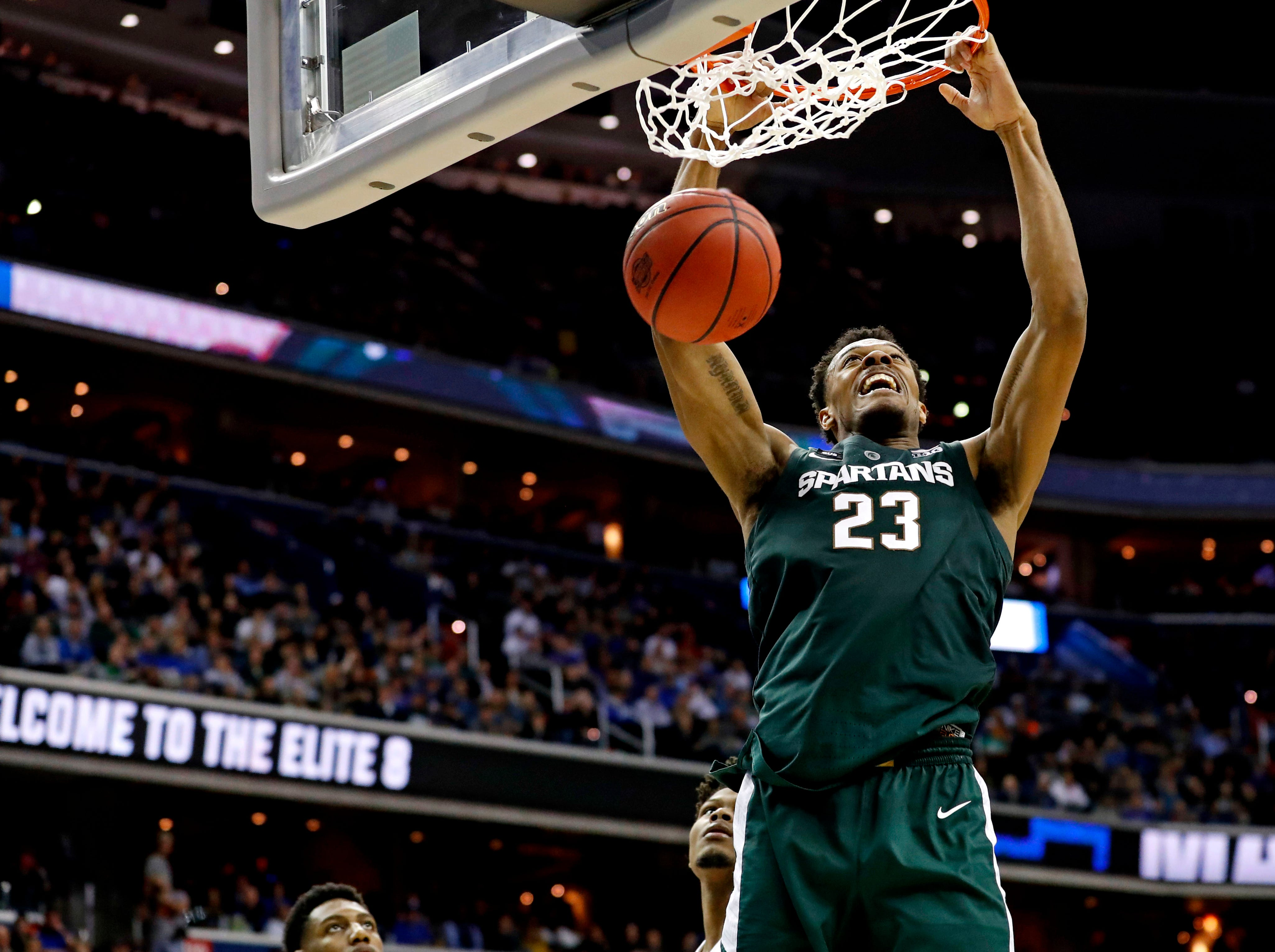 Mar 31, 2019; Washington, DC, USA; Michigan State Spartans forward Xavier Tillman (23) dunks the ball against the Duke Blue Devils during the second half in the championship game of the east regional of the 2019 NCAA Tournament at Capital One Arena. Mandatory Credit: Geoff Burke-USA TODAY Sports