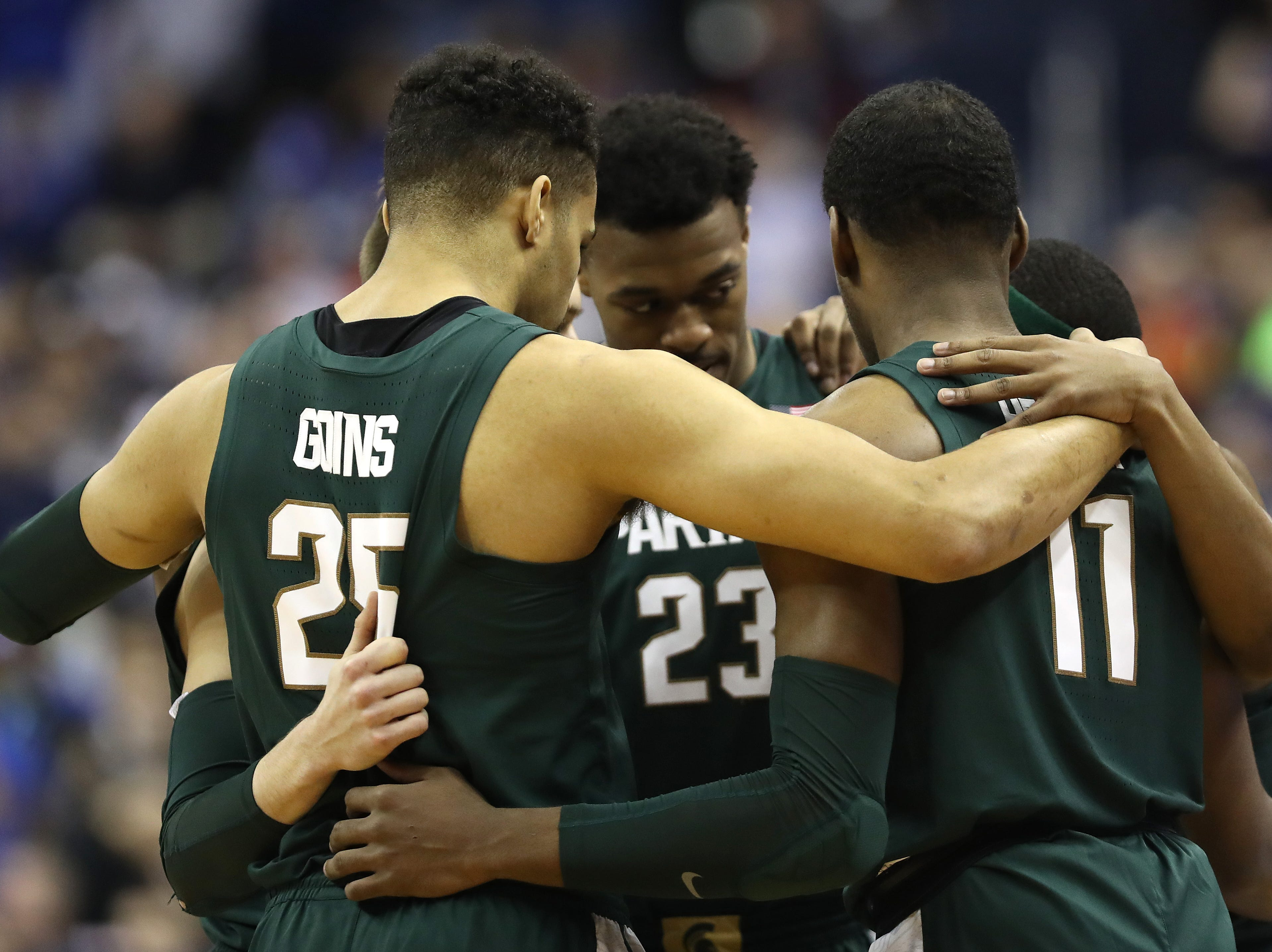 Kenny Goins #25, Xavier Tillman #23 and Aaron Henry #11 of the Michigan State Spartans huddle up prior to the East Regional game of the 2019 NCAA Men's Basketball Tournament at Capital One Arena on March 31, 2019 in Washington, DC.