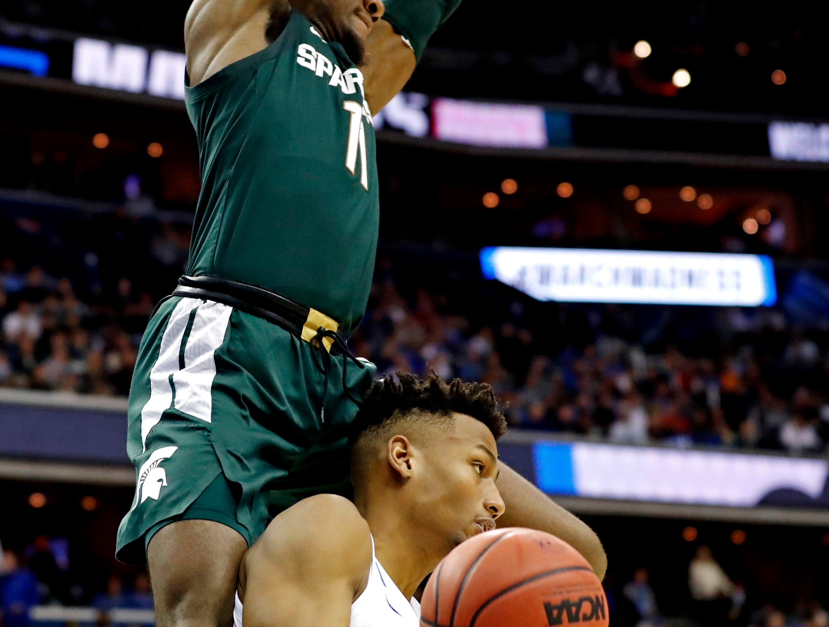 Mar 31, 2019; Washington, DC, USA; Michigan State Spartans forward Aaron Henry (11) dunks the ball against Duke Blue Devils forward Javin DeLaurier (12) during the second half in the championship game of the east regional of the 2019 NCAA Tournament at Capital One Arena. Mandatory Credit: Geoff Burke-USA TODAY Sports