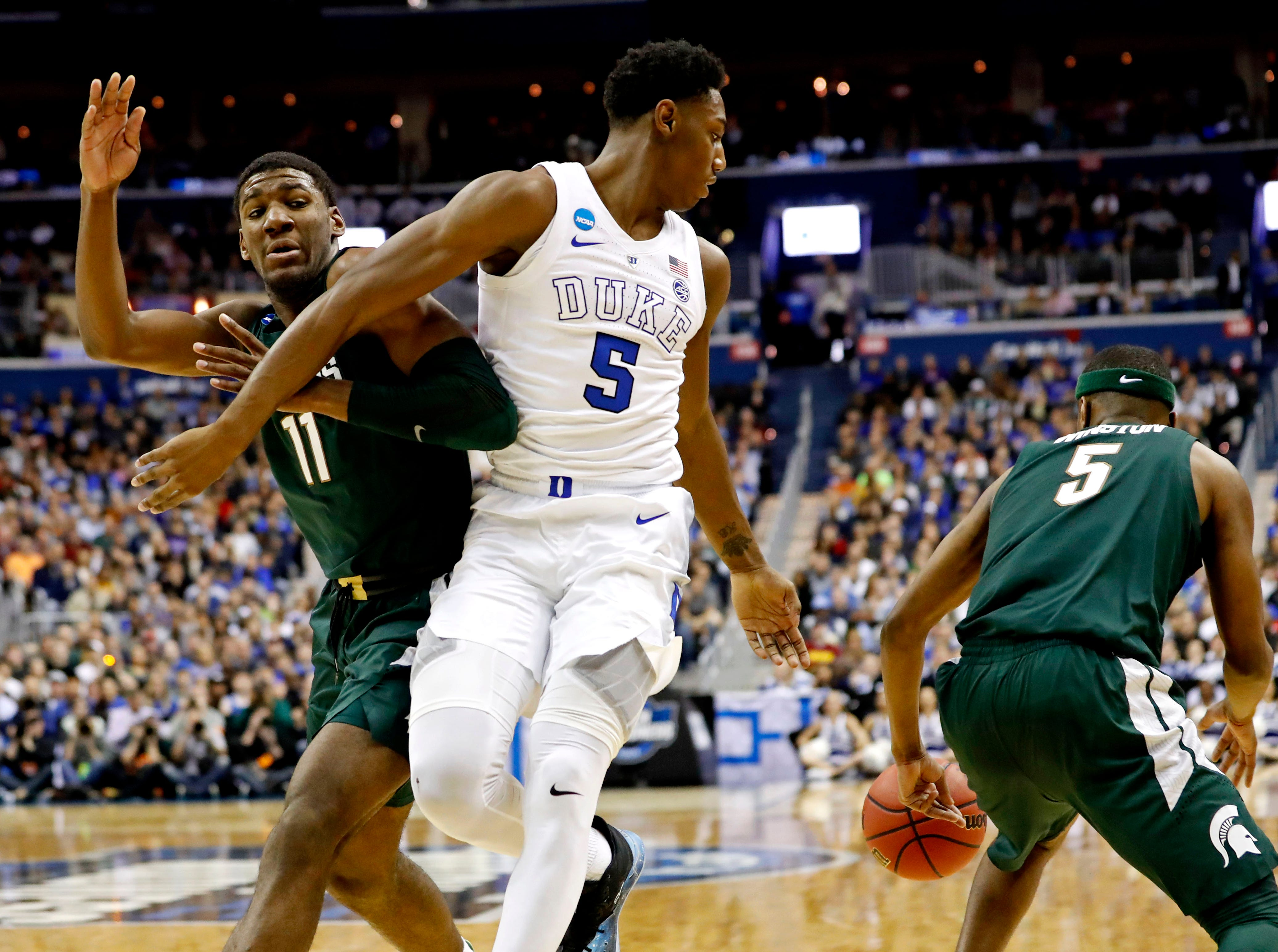 Mar 31, 2019; Washington, DC, USA; Michigan State Spartans guard Cassius Winston (5) and forward Aaron Henry (11) steals the ball from Duke Blue Devils forward RJ Barrett (5) during the first half in the championship game of the east regional of the 2019 NCAA Tournament at Capital One Arena. Mandatory Credit: Geoff Burke-USA TODAY Sports
