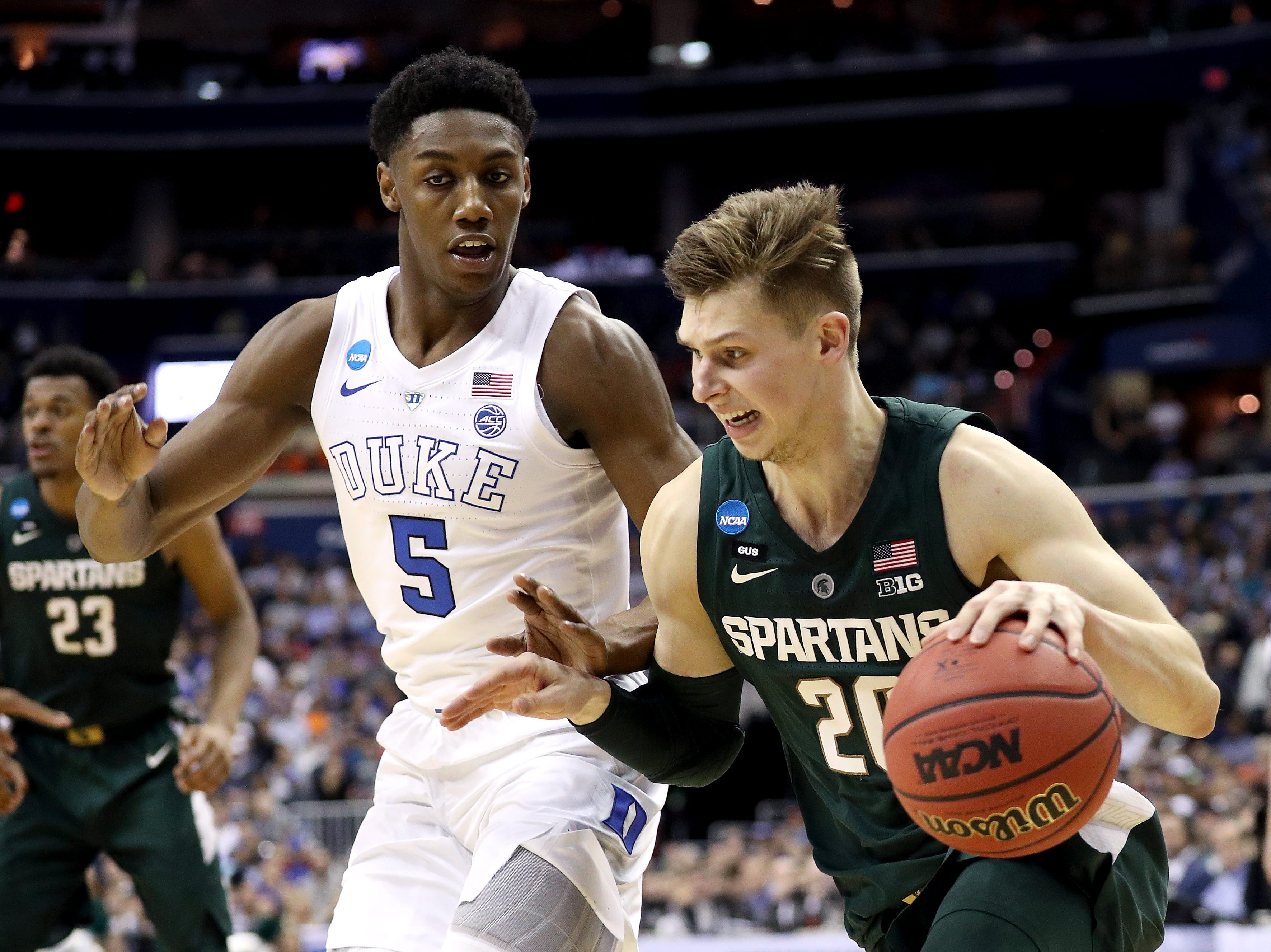 Matt McQuaid #20 of the Michigan State Spartans is defended by RJ Barrett #5 of the Duke Blue Devils during the first half in the East Regional game of the 2019 NCAA Men's Basketball Tournament at Capital One Arena on March 31, 2019 in Washington, DC.