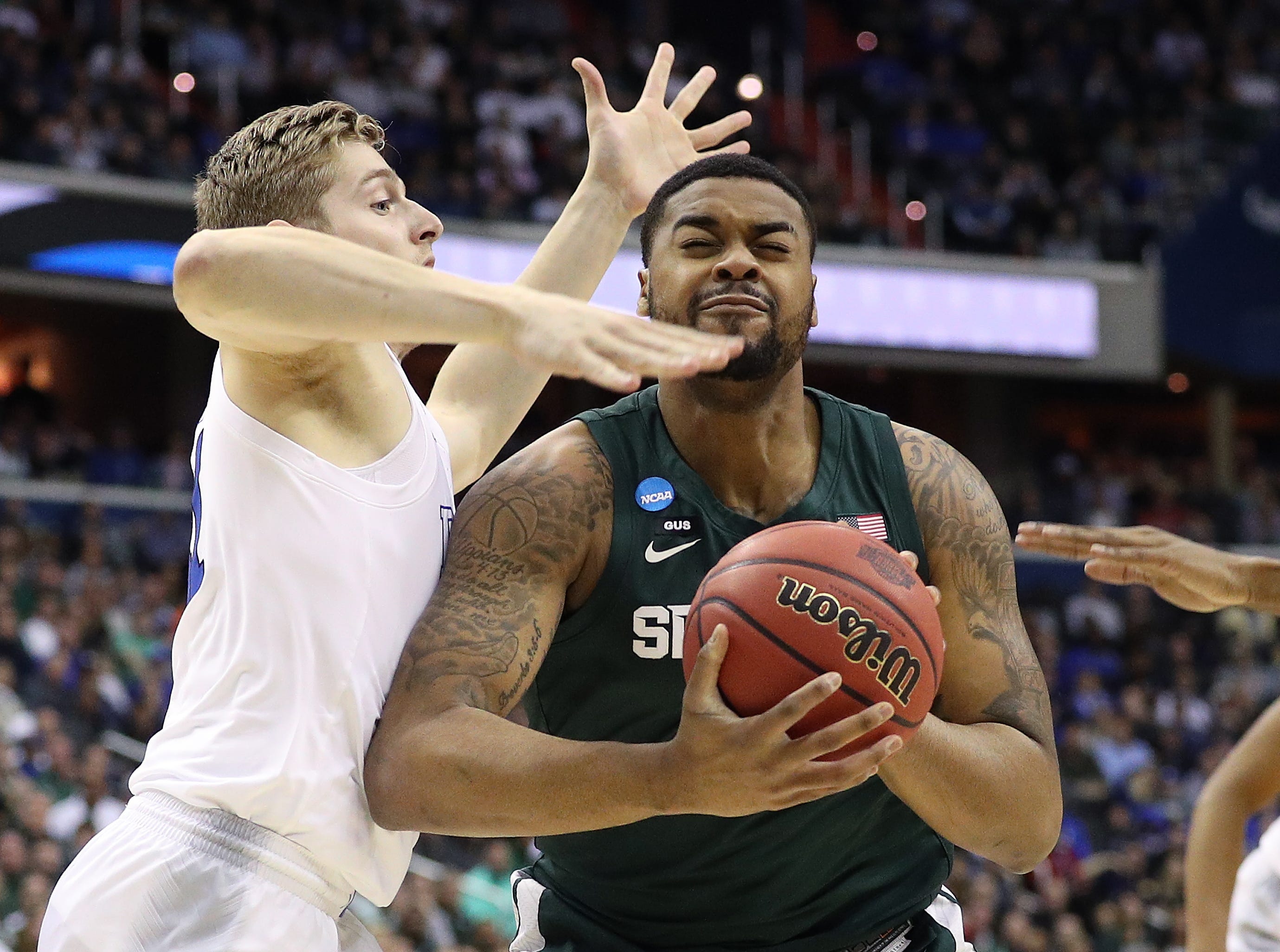 Nick Ward #44 of the Michigan State Spartans attempts a shot against Jack White #41 of the Duke Blue Devils during the first half in the East Regional game of the 2019 NCAA Men's Basketball Tournament at Capital One Arena on March 31, 2019 in Washington, DC.