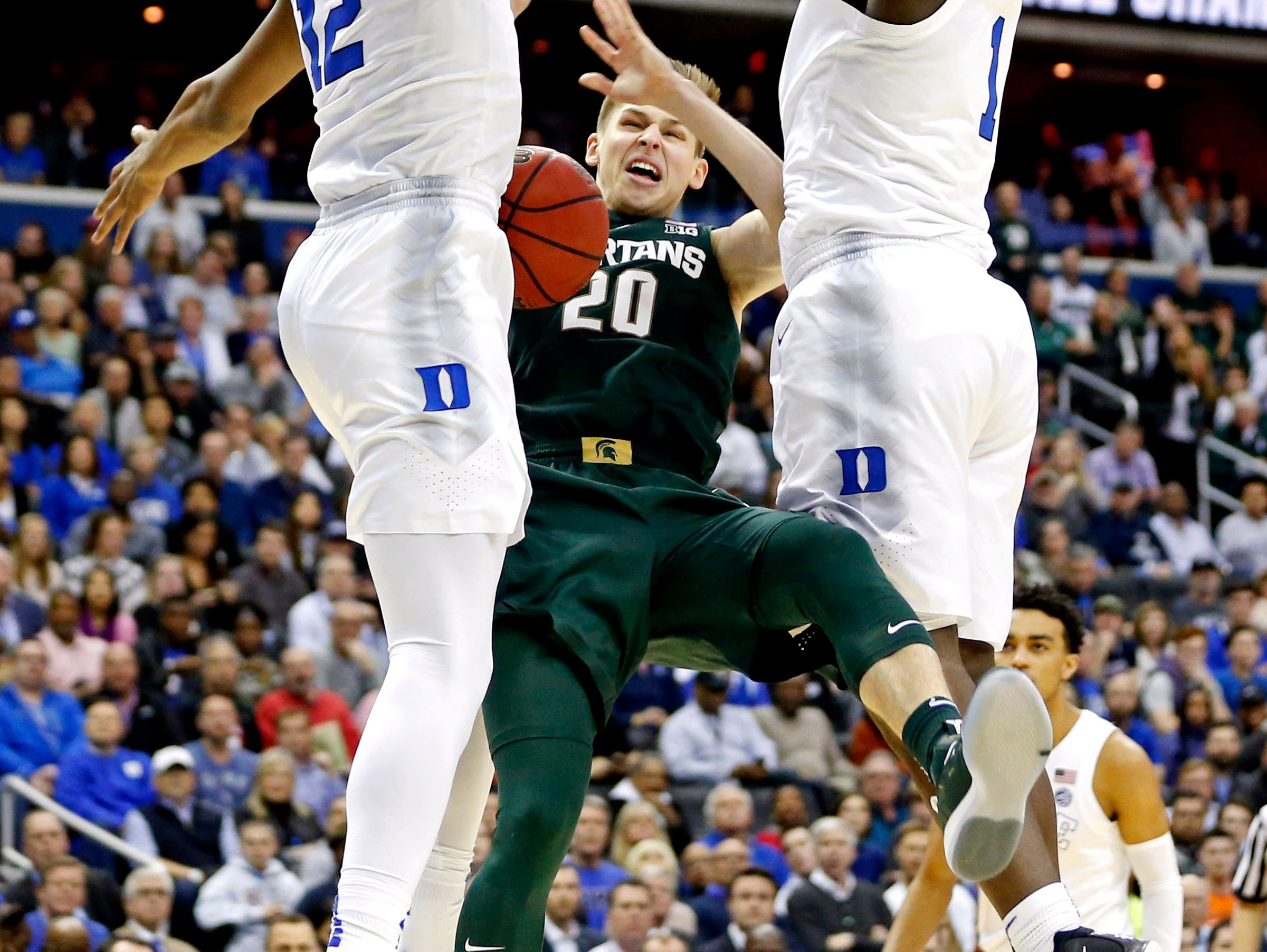 Mar 31, 2019; Washington, DC, USA; Michigan State Spartans guard Matt McQuaid (20) drives to the basket against Duke Blue Devils forward Zion Williamson (1) during the first half in the championship game of the east regional of the 2019 NCAA Tournament at Capital One Arena. Mandatory Credit: Amber Searls-USA TODAY Sports