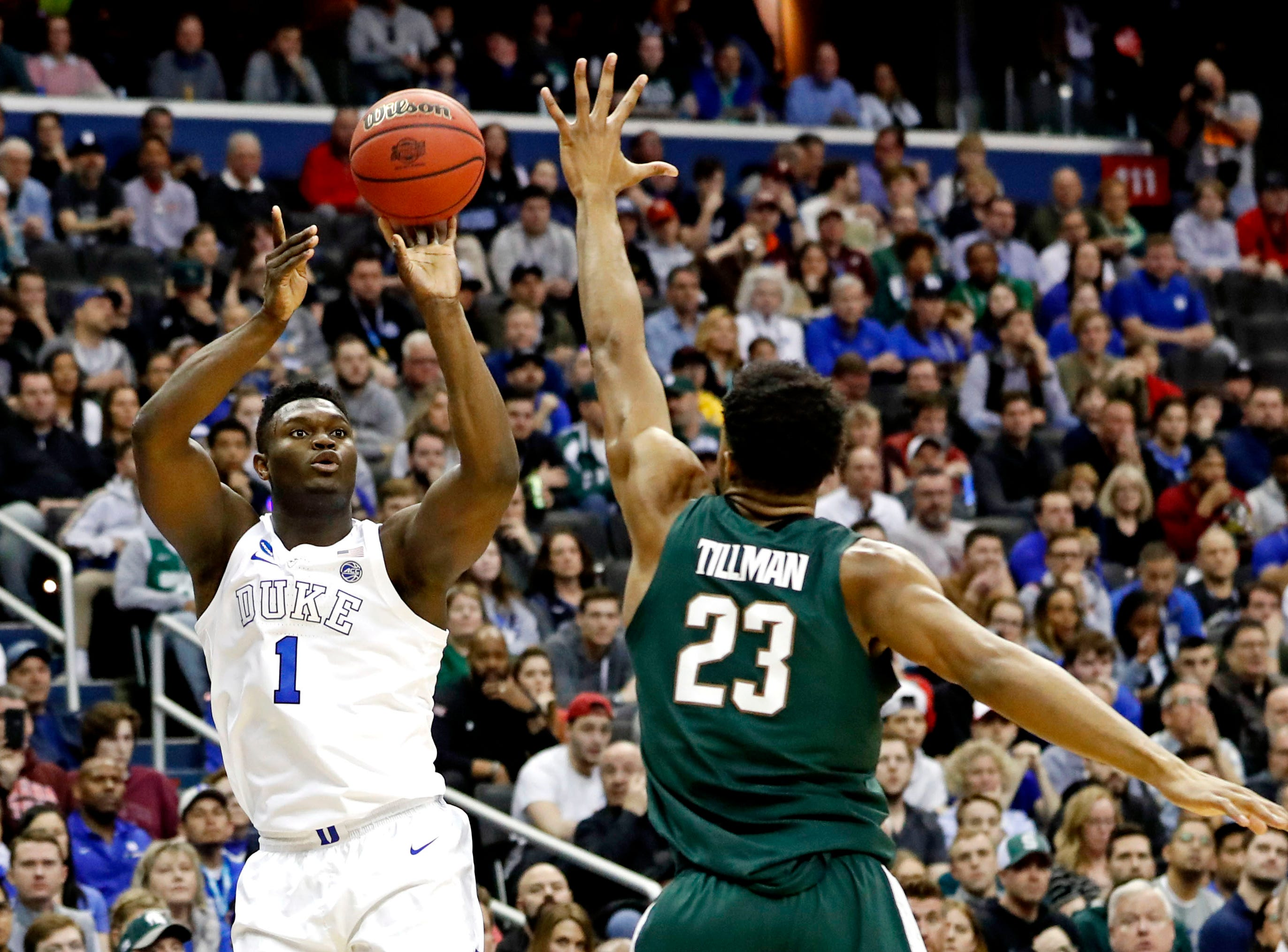 Mar 31, 2019; Washington, DC, USA; Duke Blue Devils forward Zion Williamson (1) shoots the ball against Michigan State Spartans forward Xavier Tillman (23) during the second half in the championship game of the east regional of the 2019 NCAA Tournament at Capital One Arena. Mandatory Credit: Geoff Burke-USA TODAY Sports