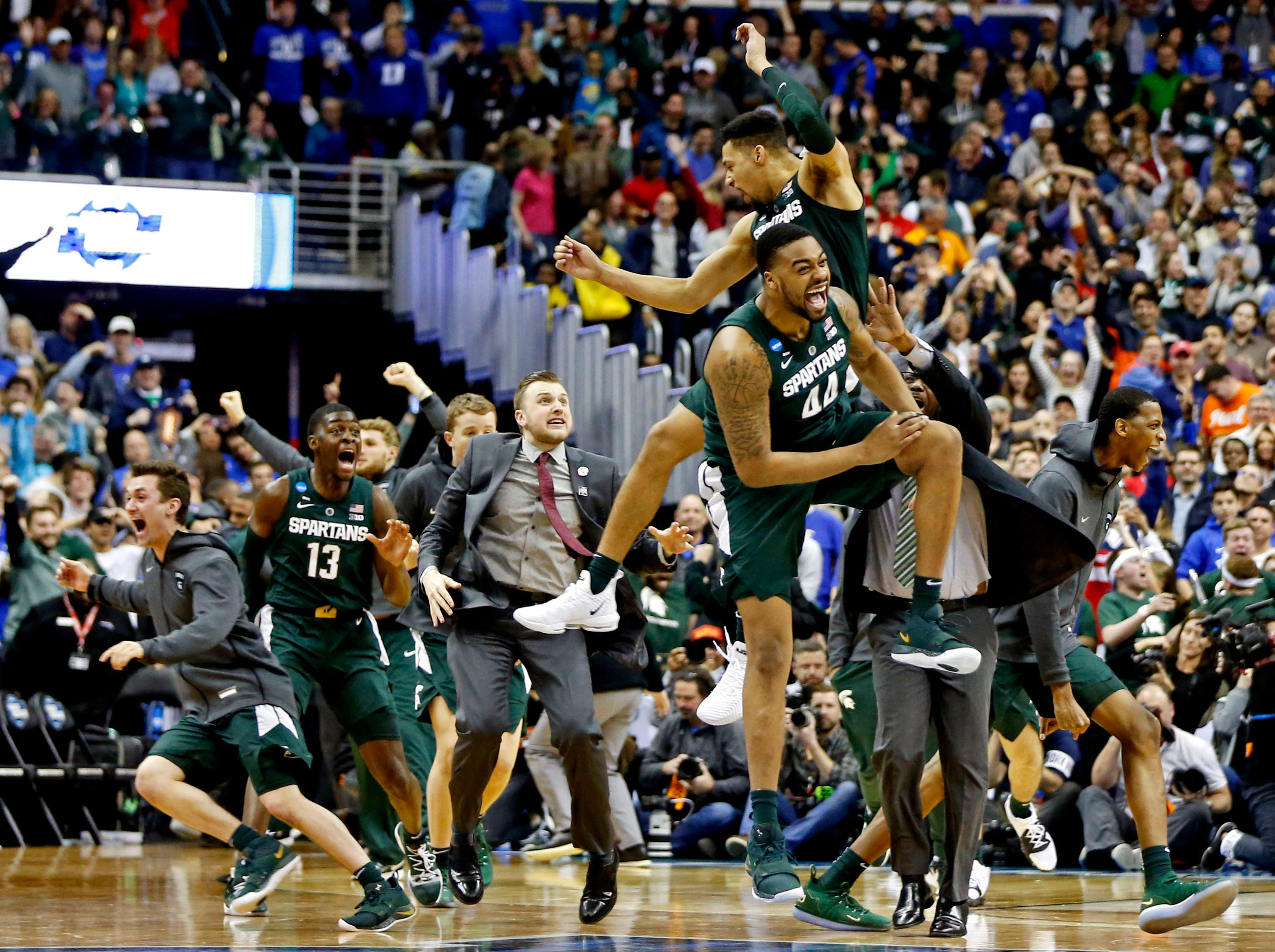 Mar 31, 2019; Washington, DC, USA; Michigan State Spartans forward Nick Ward (44) and Michigan State Spartans forward Kenny Goins (25) celebrate after beating the Duke Blue Devils in the championship game of the east regional of the 2019 NCAA Tournament at Capital One Arena. Mandatory Credit: Amber Searls-USA TODAY Sports