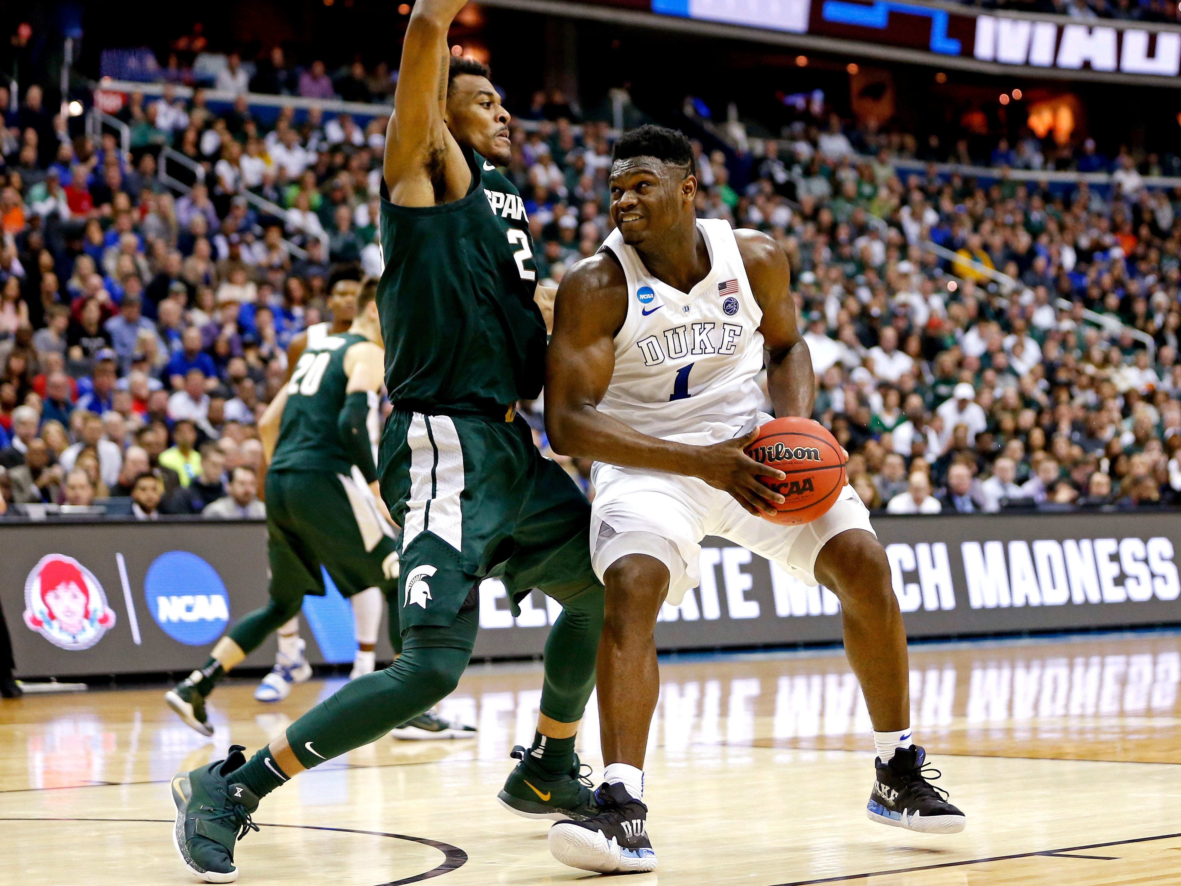 Mar 31, 2019; Washington, DC, USA; Duke Blue Devils forward Zion Williamson (1) drives to the basket against Michigan State Spartans forward Xavier Tillman (23) during the second half in the championship game of the east regional of the 2019 NCAA Tournament at Capital One Arena. Mandatory Credit: Amber Searls-USA TODAY Sports