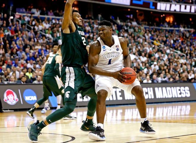 Xavier Tillman scored 19 points and grabbed nine rebounds against Xavier Tillman during last March's NCAA tournament regional final in Washington D.C.