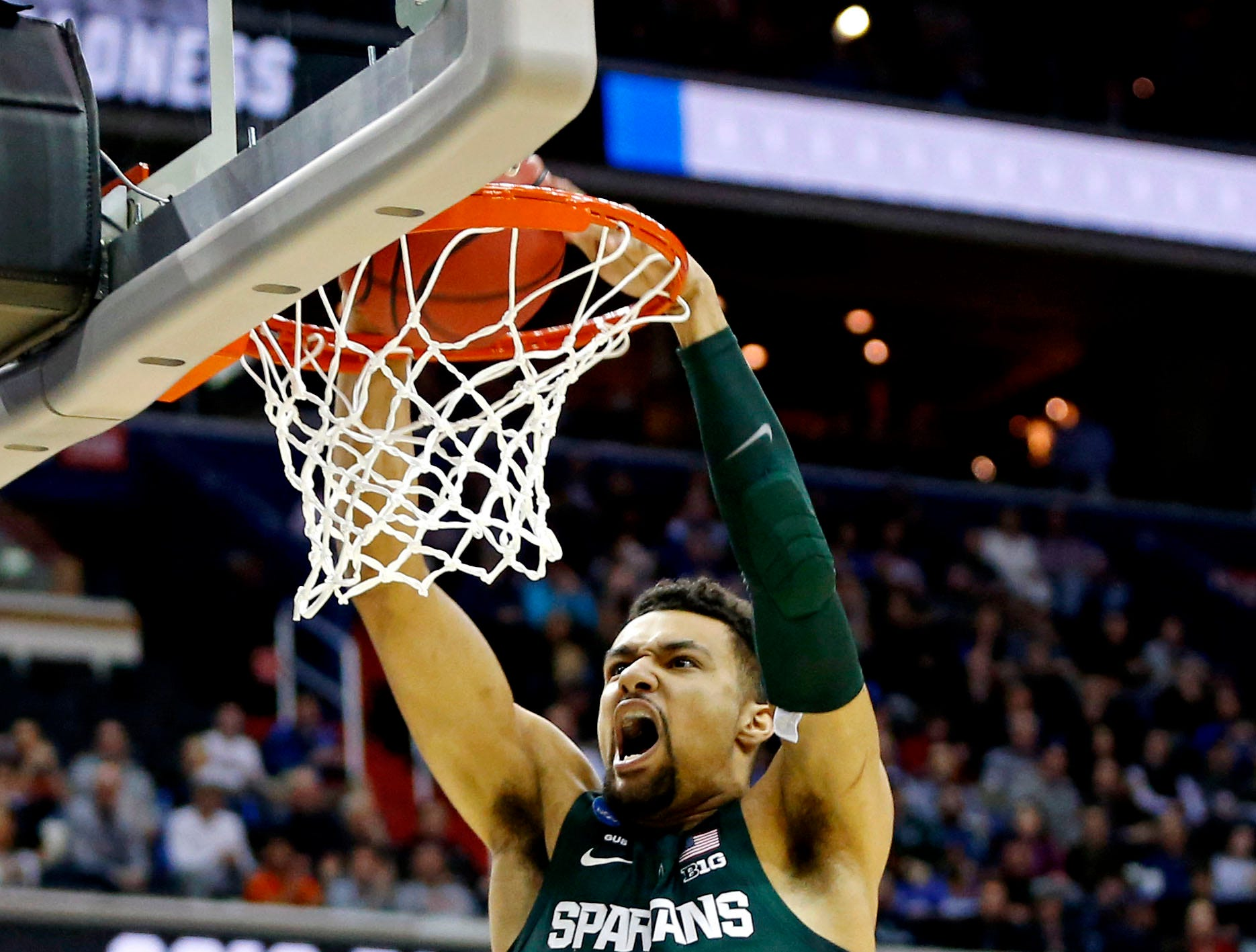Mar 31, 2019; Washington, DC, USA;Michigan State Spartans forward Kenny Goins (25) dunks the ball during the first half against the Duke Blue Devils in the championship game of the east regional of the 2019 NCAA Tournament at Capital One Arena.