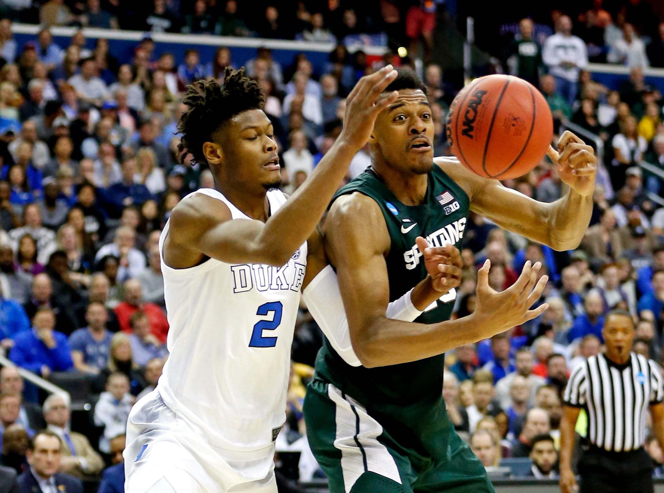 Mar 31, 2019; Washington, DC, USA; Michigan State Spartans forward Xavier Tillman (23) and Duke Blue Devils forward Cam Reddish (2) go for a loose ball during the first half in the championship game of the east regional of the 2019 NCAA Tournament at Capital One Arena. Mandatory Credit: Amber Searls-USA TODAY Sports