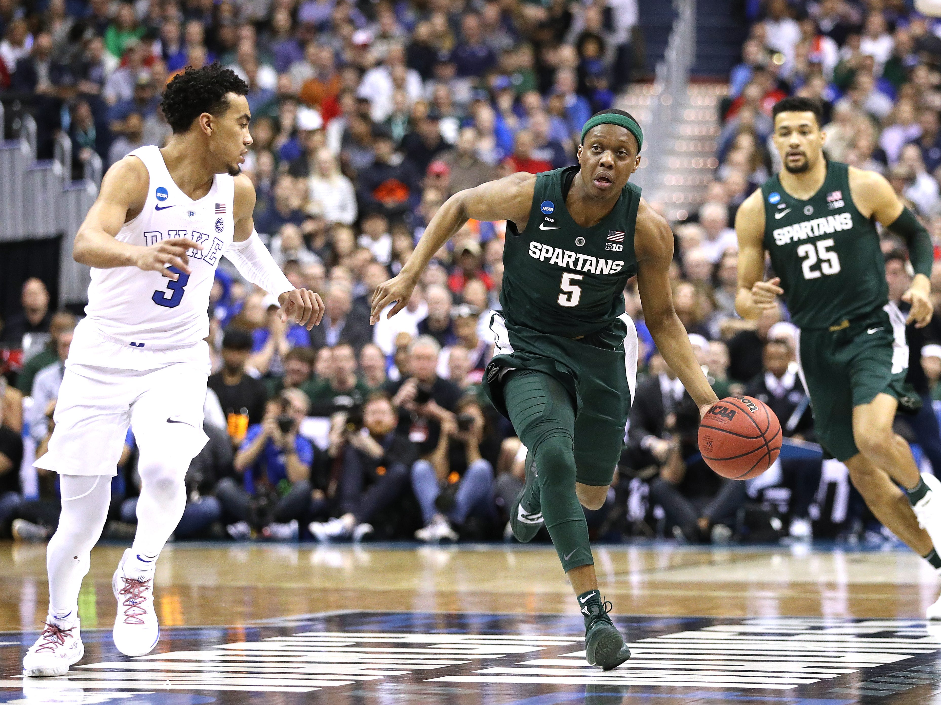 Cassius Winston #5 of the Michigan State Spartans is defended by Tre Jones #3 of the Duke Blue Devils during the first half in the East Regional game of the 2019 NCAA Men's Basketball Tournament at Capital One Arena on March 31, 2019 in Washington, DC.
