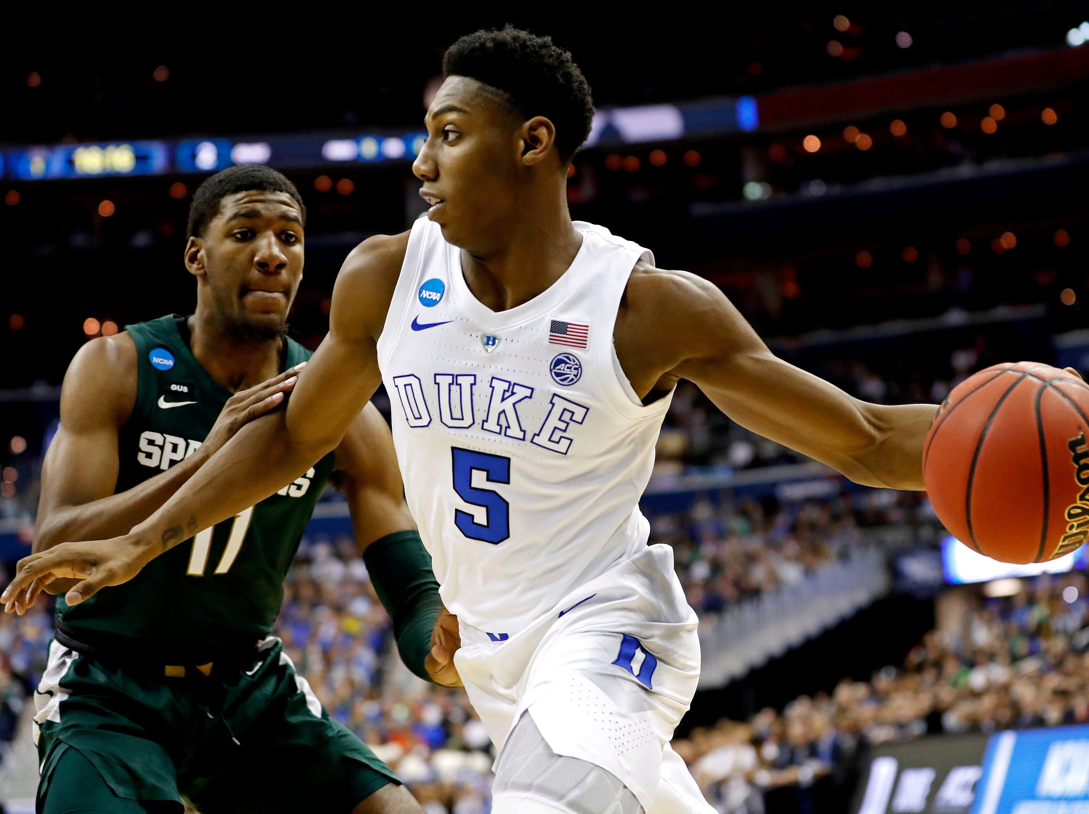 Duke Blue Devils forward RJ Barrett (5) drives to the basket against Michigan State Spartans forward Aaron Henry (11) during the first half in the championship game of the east regional of the 2019 NCAA Tournament at Capital One Arena.