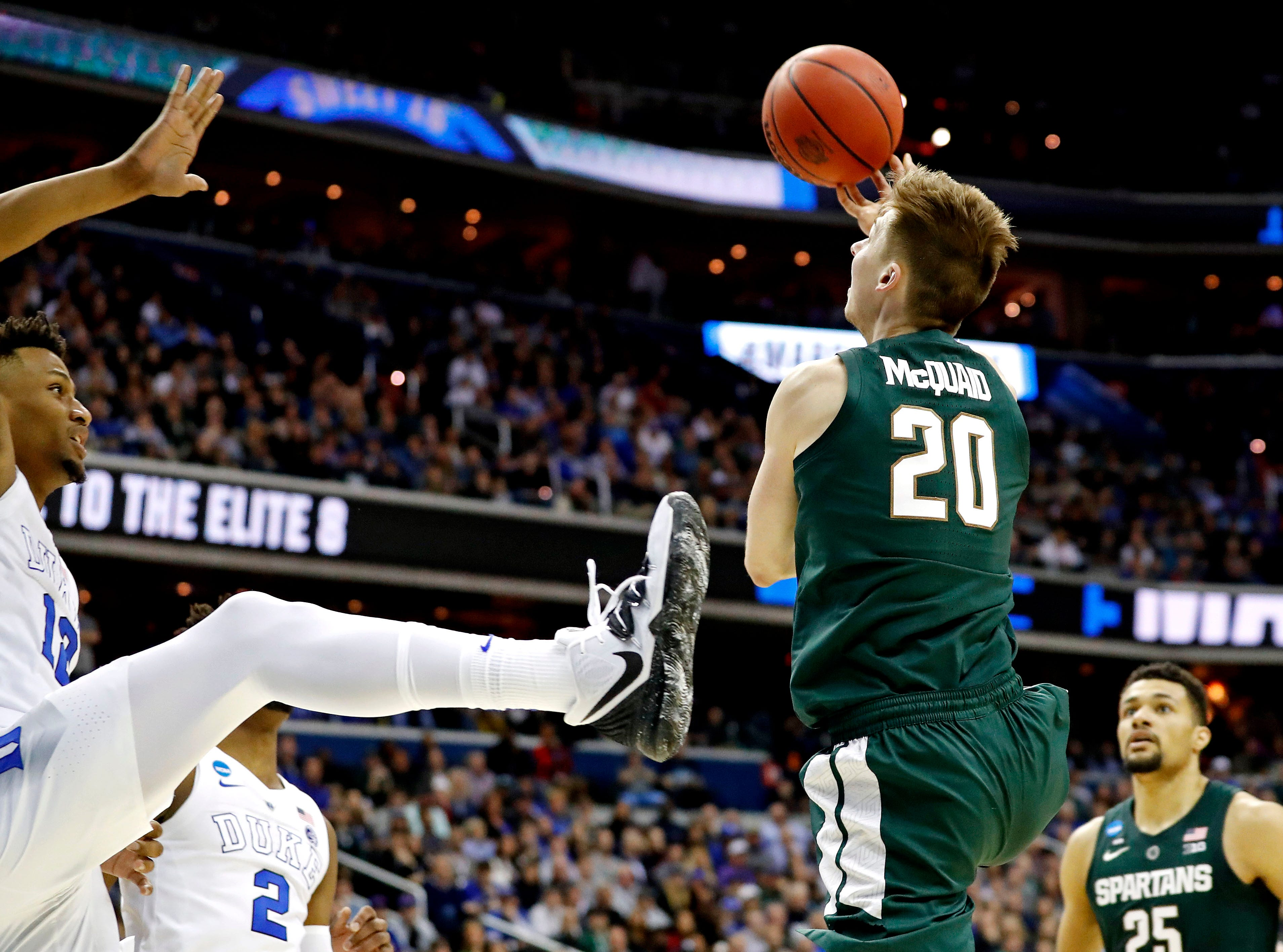Mar 31, 2019; Washington, DC, USA; Michigan State Spartans guard Matt McQuaid (20) shoots the ball against Duke Blue Devils forward Javin DeLaurier (12) during the second half in the championship game of the east regional of the 2019 NCAA Tournament at Capital One Arena. Mandatory Credit: Geoff Burke-USA TODAY Sports