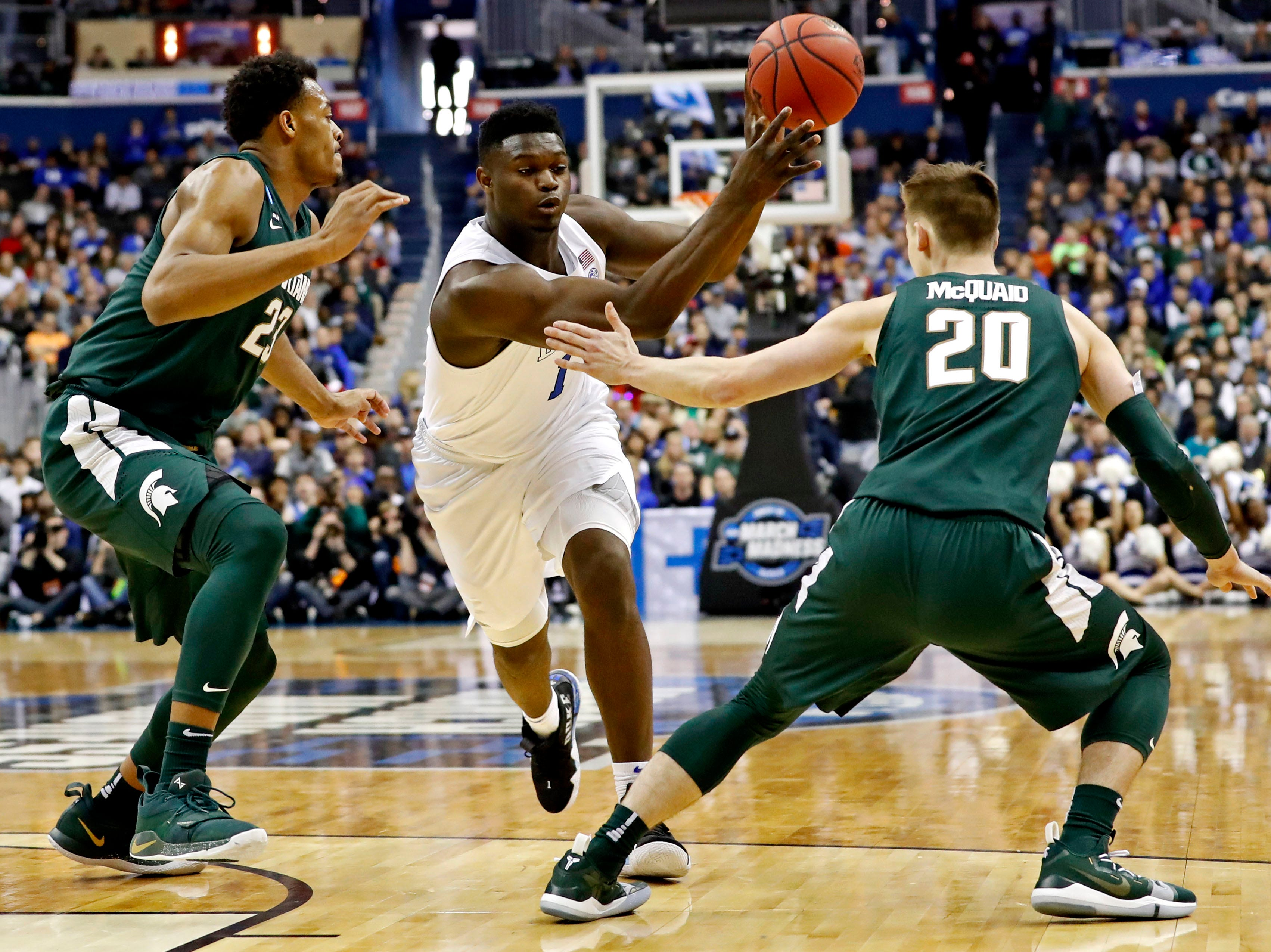 Mar 31, 2019; Washington, DC, USA; Duke Blue Devils forward Zion Williamson (1) passes the ball against Michigan State Spartans guard Matt McQuaid (20) during the first half in the championship game of the east regional of the 2019 NCAA Tournament at Capital One Arena. Mandatory Credit: Geoff Burke-USA TODAY Sports