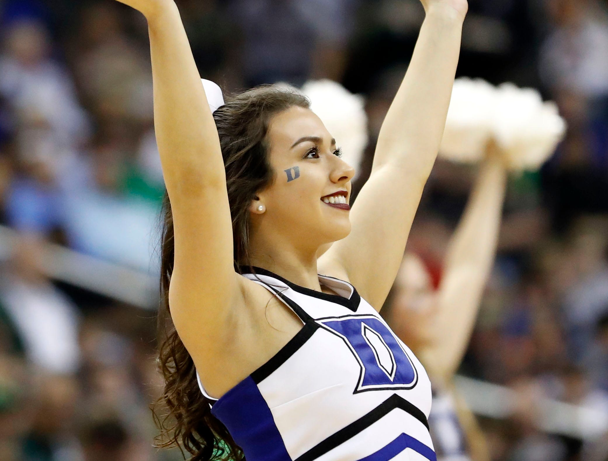 Mar 31, 2019; Washington, DC, USA; Duke Blue Devils cheerleader during the first half against the Michigan State Spartans in the championship game of the east regional of the 2019 NCAA Tournament at Capital One Arena. Mandatory Credit: Geoff Burke-USA TODAY Sports