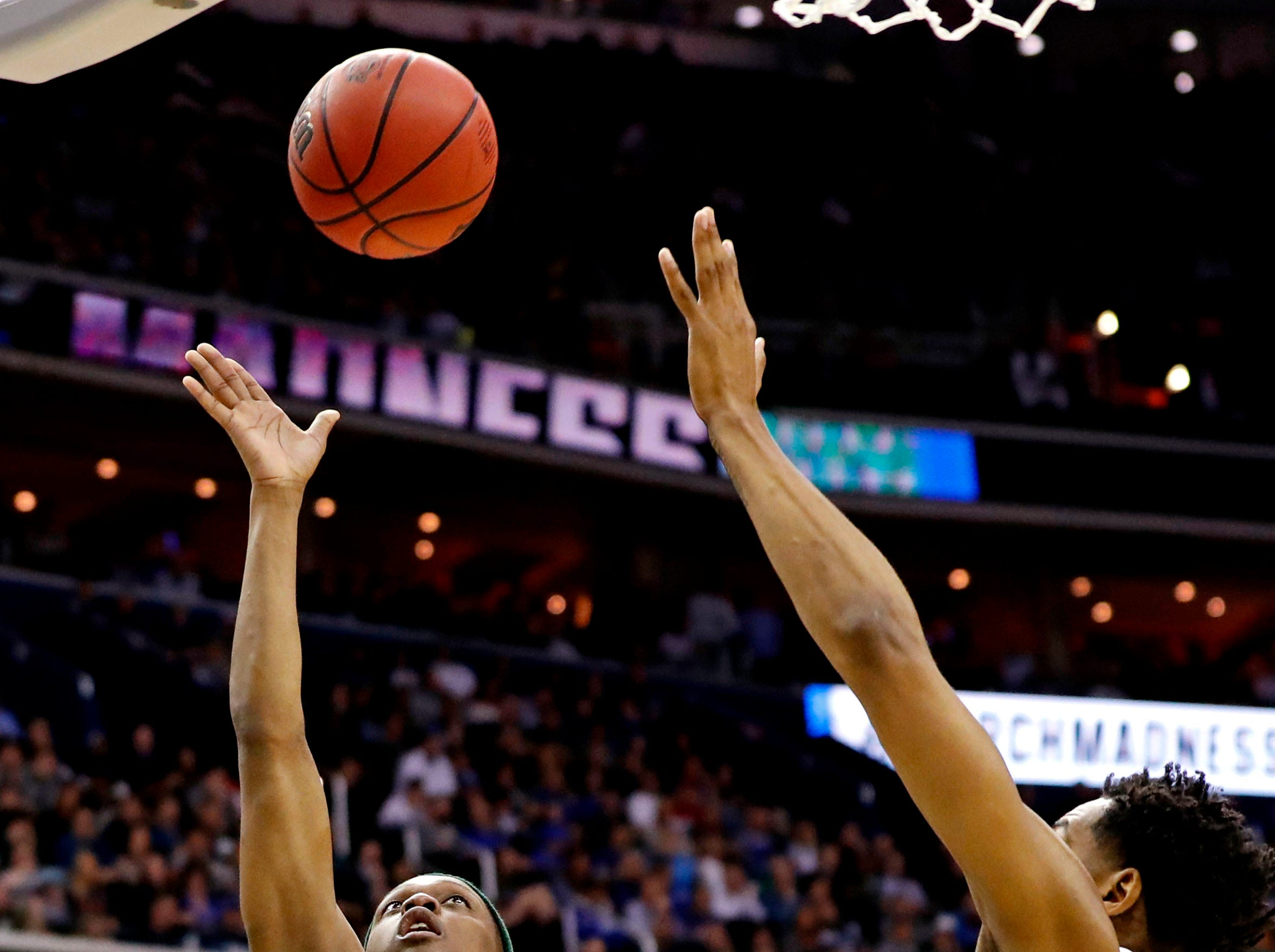 Mar 31, 2019; Washington, DC, USA; Michigan State Spartans guard Cassius Winston (5) shoots the ball against Duke Blue Devils center Marques Bolden (20) during the second half in the championship game of the east regional of the 2019 NCAA Tournament at Capital One Arena. Mandatory Credit: Geoff Burke-USA TODAY Sports