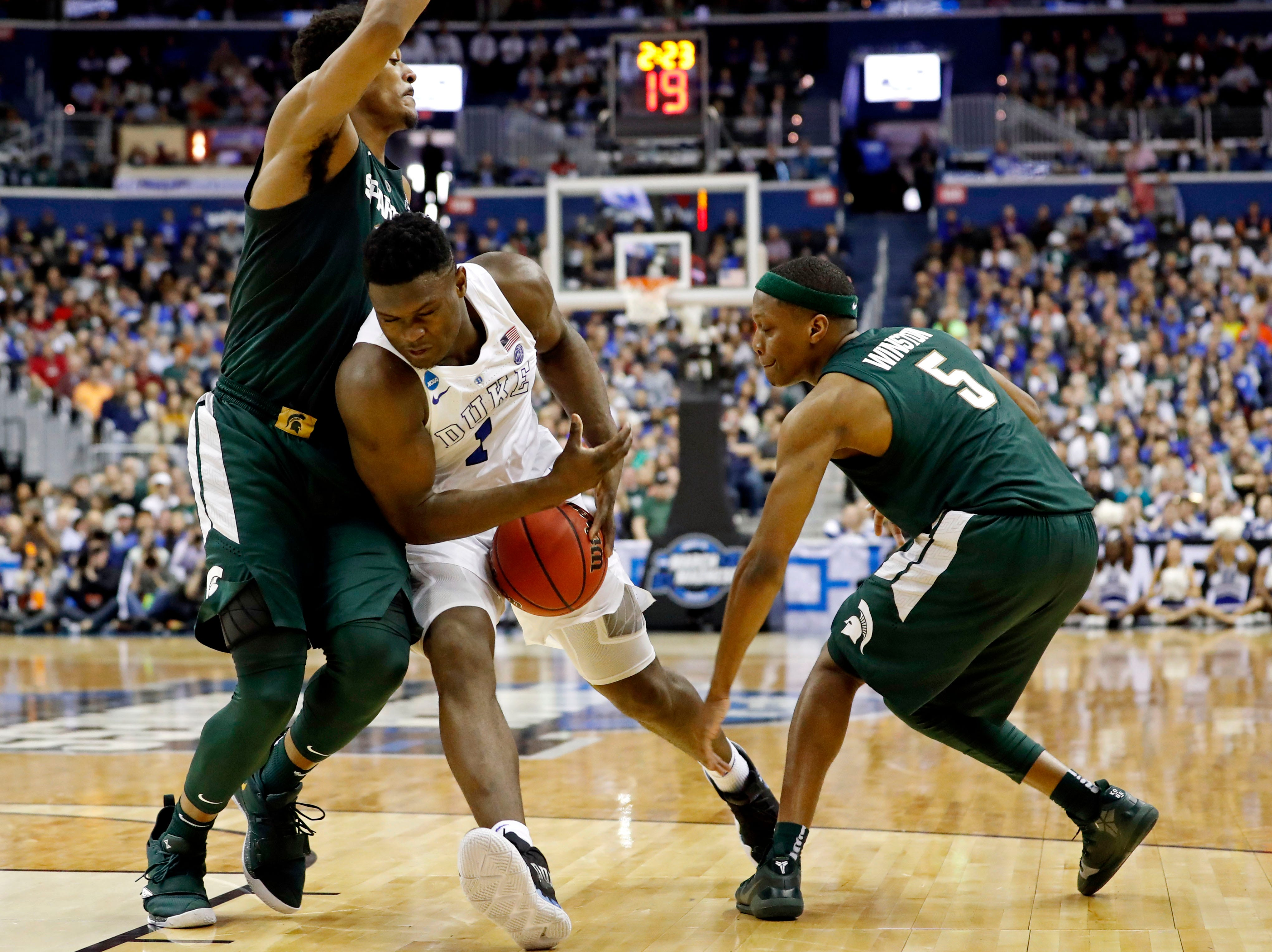 Mar 31, 2019; Washington, DC, USA; Duke Blue Devils forward Zion Williamson (1) drives to the basket against Michigan State Spartans guard Cassius Winston (5) during the first half in the championship game of the east regional of the 2019 NCAA Tournament at Capital One Arena. Mandatory Credit: Geoff Burke-USA TODAY Sports