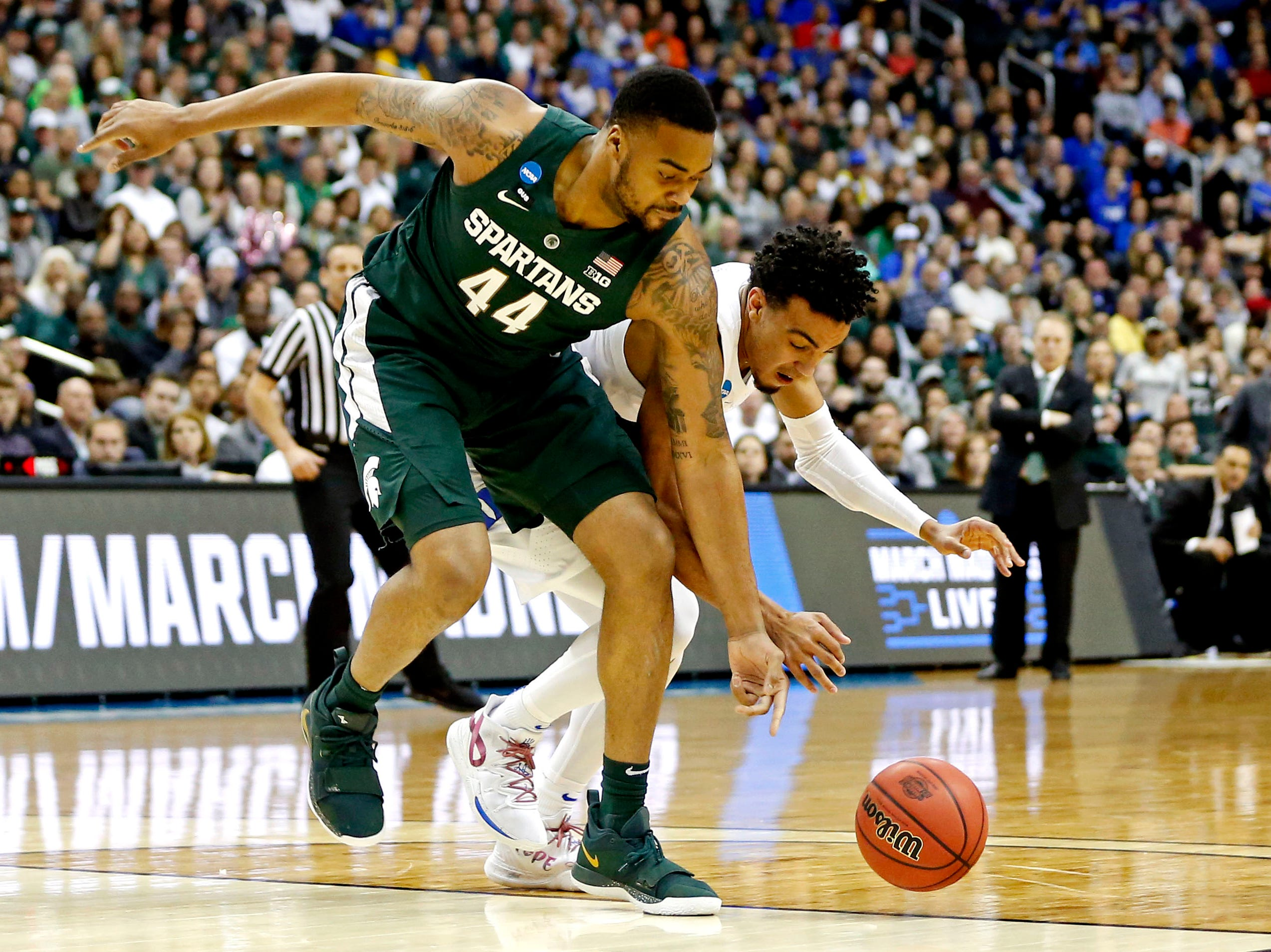 Mar 31, 2019; Washington, DC, USA; Duke Blue Devils guard Tre Jones (3) and Michigan State Spartans forward Nick Ward (44) go for a loose ball during the second half in the championship game of the east regional of the 2019 NCAA Tournament at Capital One Arena. Mandatory Credit: Amber Searls-USA TODAY Sports