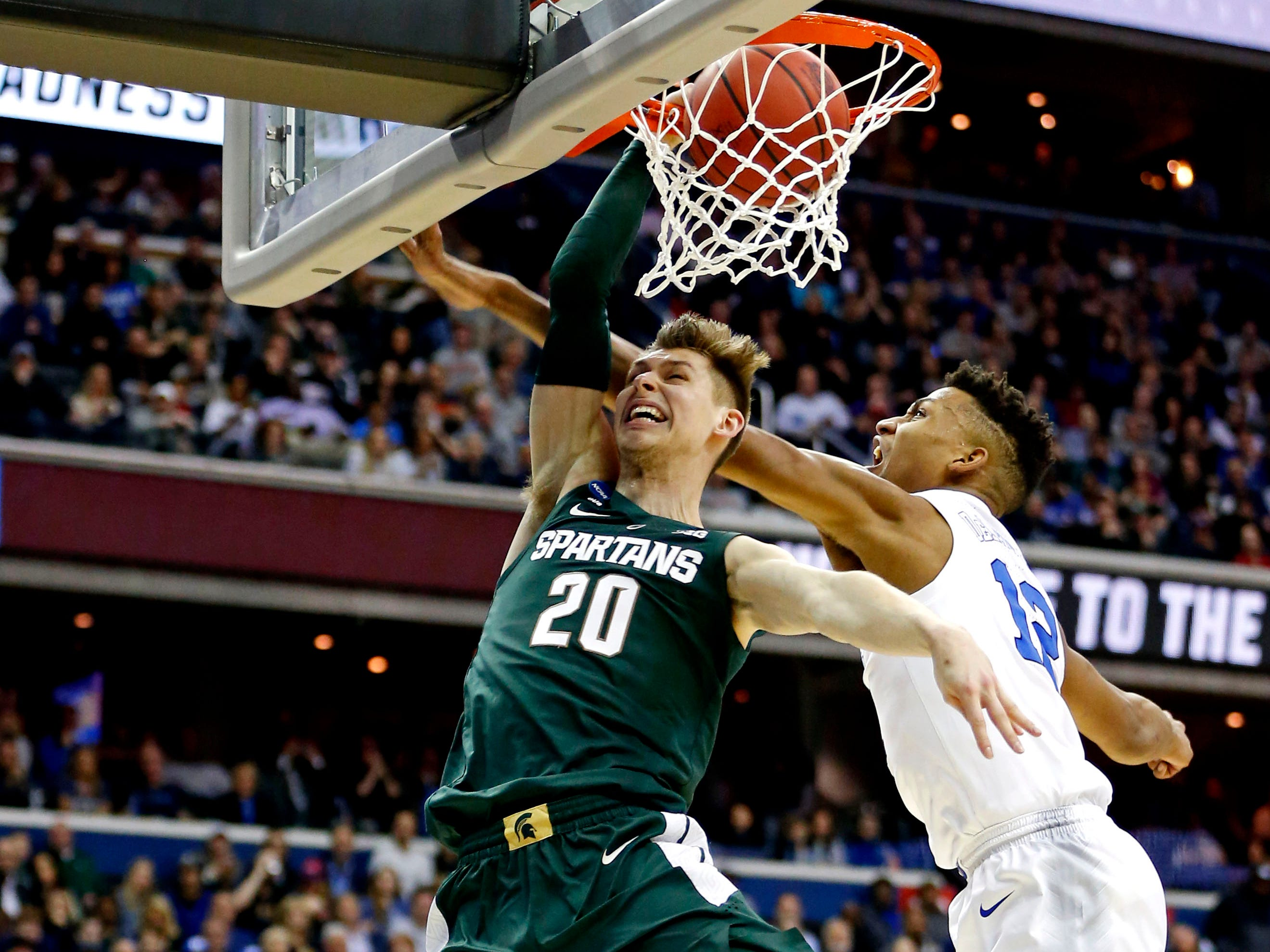 Mar 31, 2019; Washington, DC, USA; Michigan State Spartans guard Matt McQuaid (20) dunks the ball against Duke Blue Devils forward Javin DeLaurier (12) during the first half in the championship game of the east regional of the 2019 NCAA Tournament at Capital One Arena. Mandatory Credit: Amber Searls-USA TODAY Sports