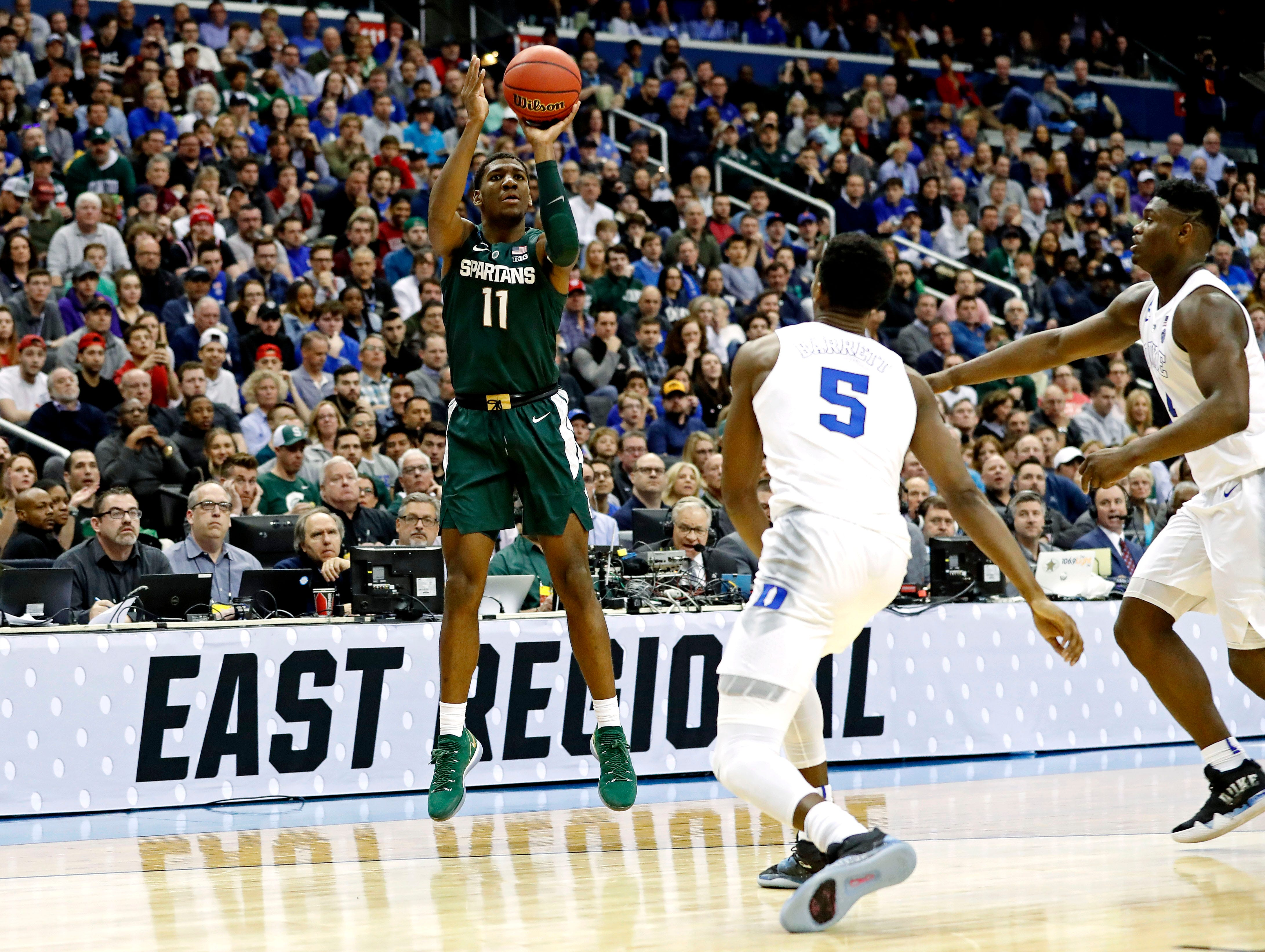 Mar 31, 2019; Washington, DC, USA; Michigan State Spartans forward Aaron Henry (11) shoots the ball against Duke Blue Devils forward RJ Barrett (5) during the second half in the championship game of the east regional of the 2019 NCAA Tournament at Capital One Arena. Mandatory Credit: Geoff Burke-USA TODAY Sports