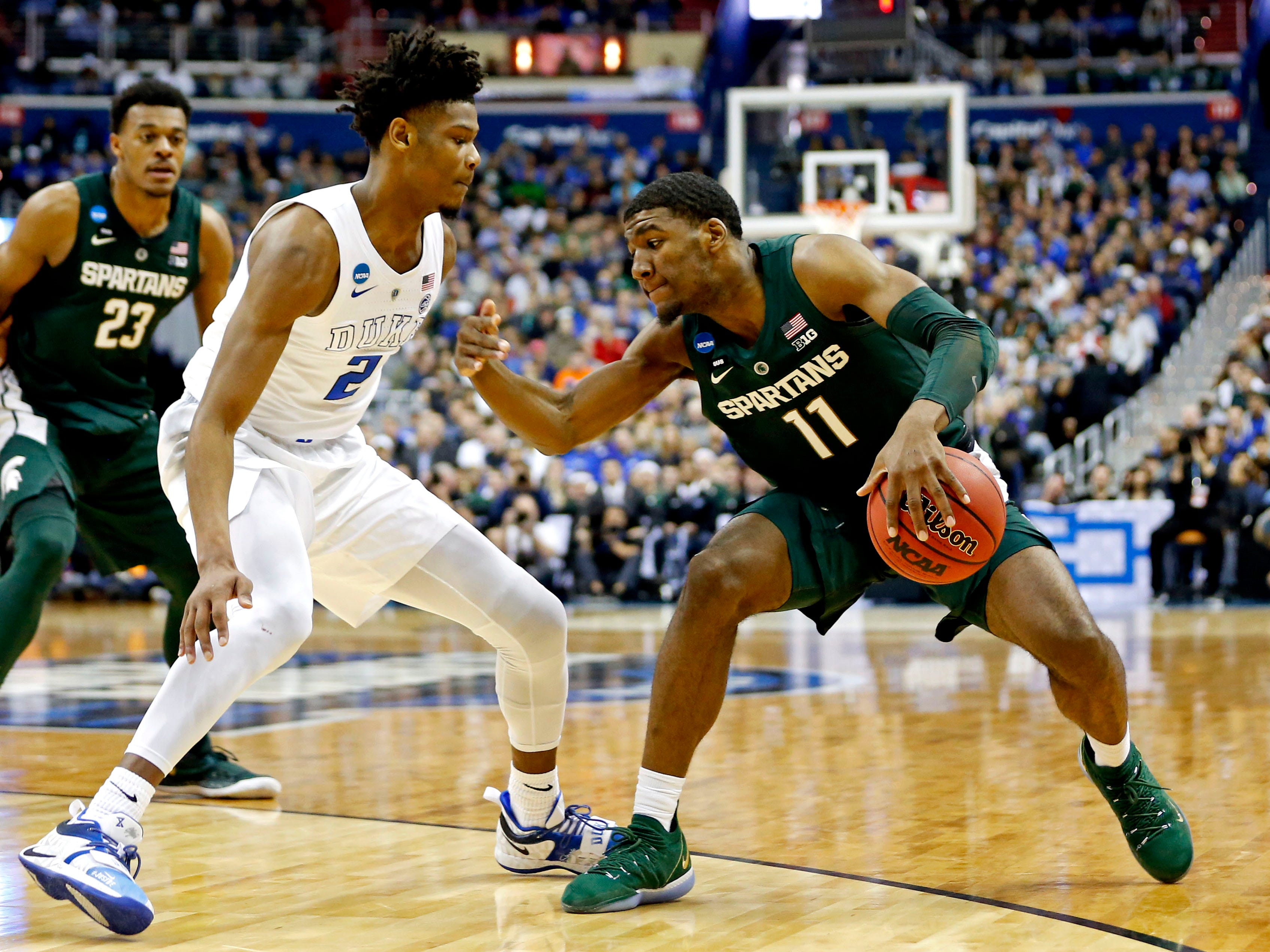 Mar 31, 2019; Washington, DC, USA; Michigan State Spartans forward Aaron Henry (11) handles the ball against Duke Blue Devils forward Cam Reddish (2) during the first half in the championship game of the east regional of the 2019 NCAA Tournament at Capital One Arena. Mandatory Credit: Amber Searls-USA TODAY Sports