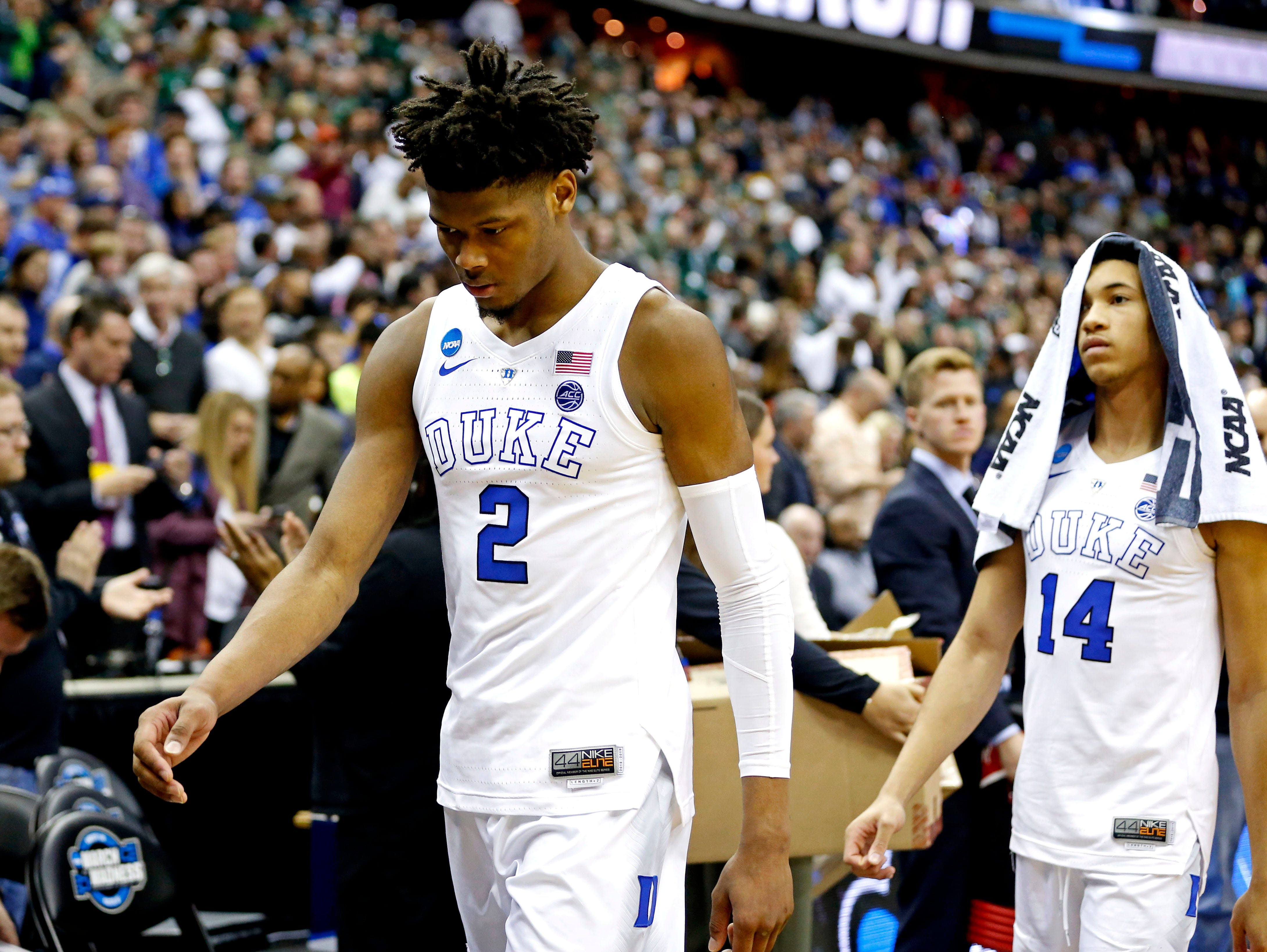 Mar 31, 2019; Washington, DC, USA; Duke Blue Devils forward Cam Reddish (2) and guard Jordan Goldwire (14) walk off the court ofter losing to the Michigan State Spartans in the championship game of the east regional of the 2019 NCAA Tournament at Capital One Arena. Mandatory Credit: Amber Searls-USA TODAY Sports