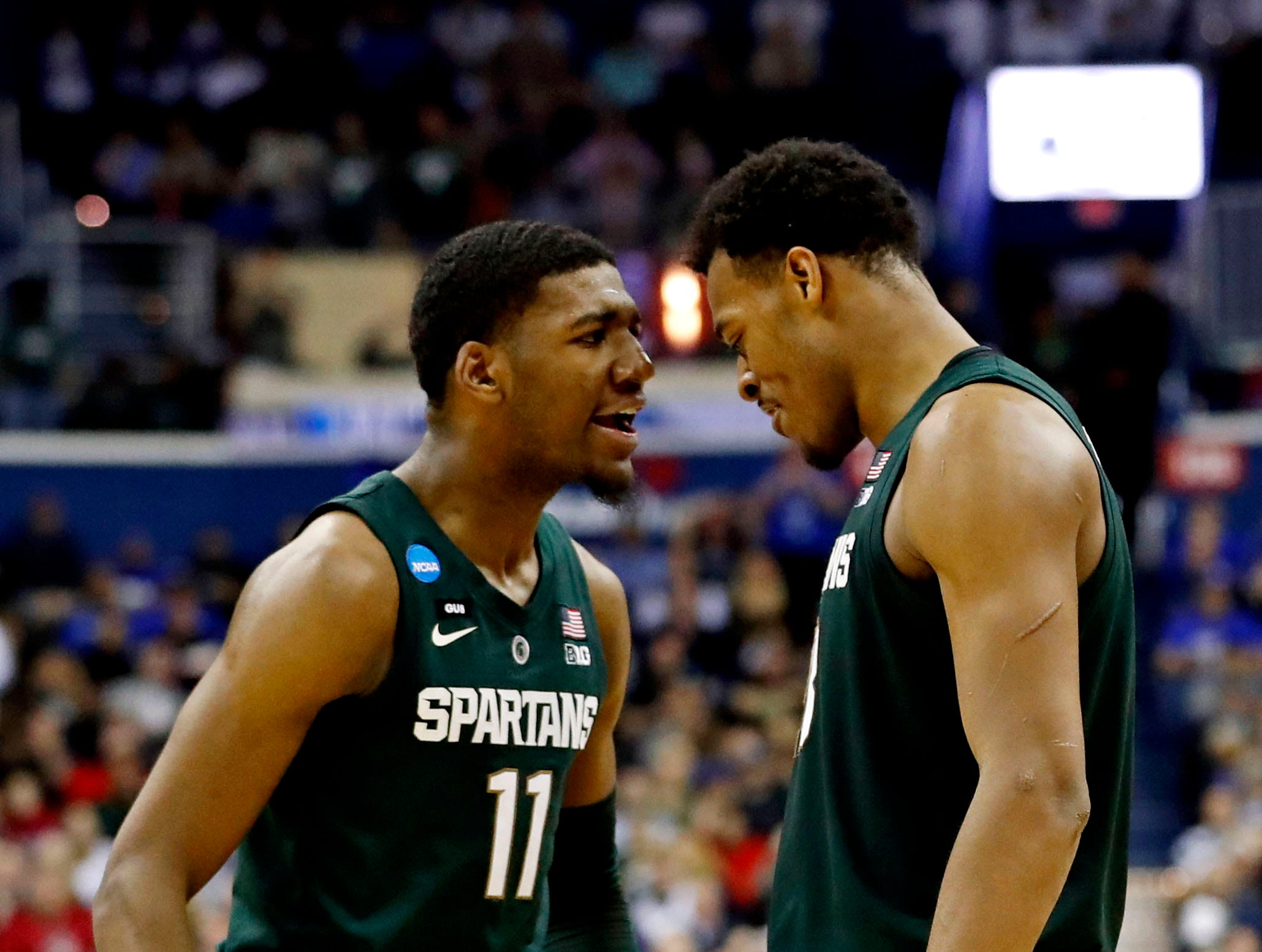 Mar 31, 2019; Washington, DC, USA; Michigan State Spartans forward Xavier Tillman (23) reacts with forward Aaron Henry (11) during the second half against the Duke Blue Devils in the championship game of the east regional of the 2019 NCAA Tournament at Capital One Arena. Mandatory Credit: Geoff Burke-USA TODAY Sports