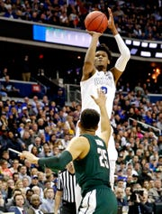 Mar 31, 2019; Washington, DC, USA; Duke Blue Devils forward Cam Reddish (2) shoots the ball against Michigan State Spartans forward Kenny Goins (25) during the first half in the championship game of the east regional of the 2019 NCAA Tournament at Capital One Arena. Mandatory Credit: Geoff Burke-USA TODAY Sports
