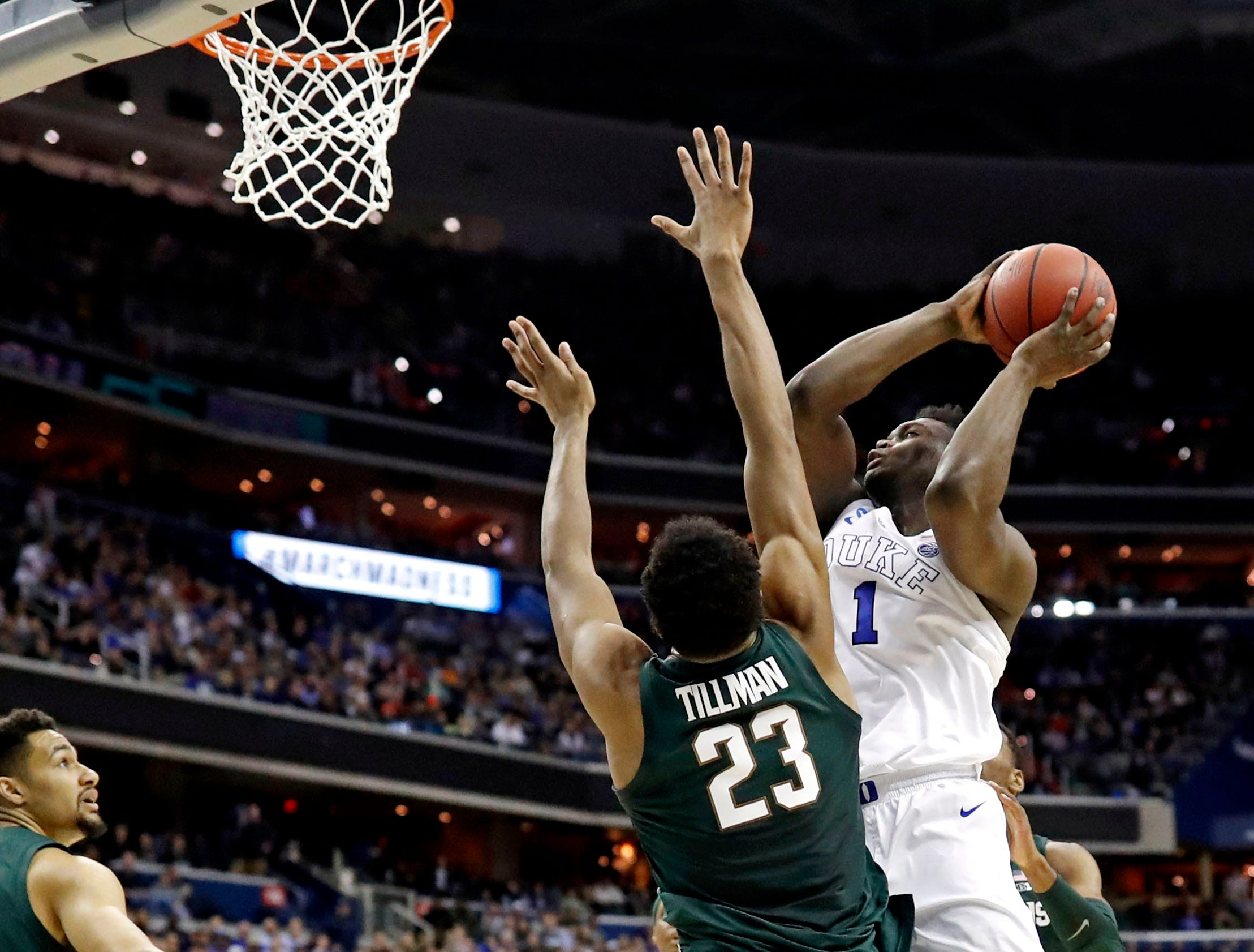 Mar 31, 2019; Washington, DC, USA; Duke Blue Devils forward Zion Williamson (1) shoots the ball against Michigan State Spartans forward Xavier Tillman (23) during the first half in the championship game of the east regional of the 2019 NCAA Tournament at Capital One Arena. Mandatory Credit: Geoff Burke-USA TODAY Sports