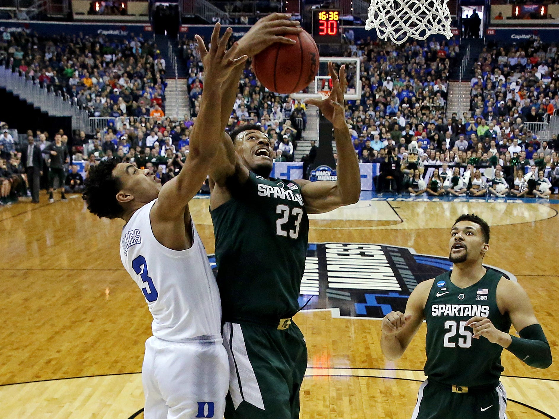 Mar 31, 2019; Washington, DC, USA; Michigan State Spartans forward Xavier Tillman (23) grabs a rebound against Duke Blue Devils guard Tre Jones (3) during the first half in the championship game of the east regional of the 2019 NCAA Tournament at Capital One Arena. Mandatory Credit: Geoff Burke-USA TODAY Sports