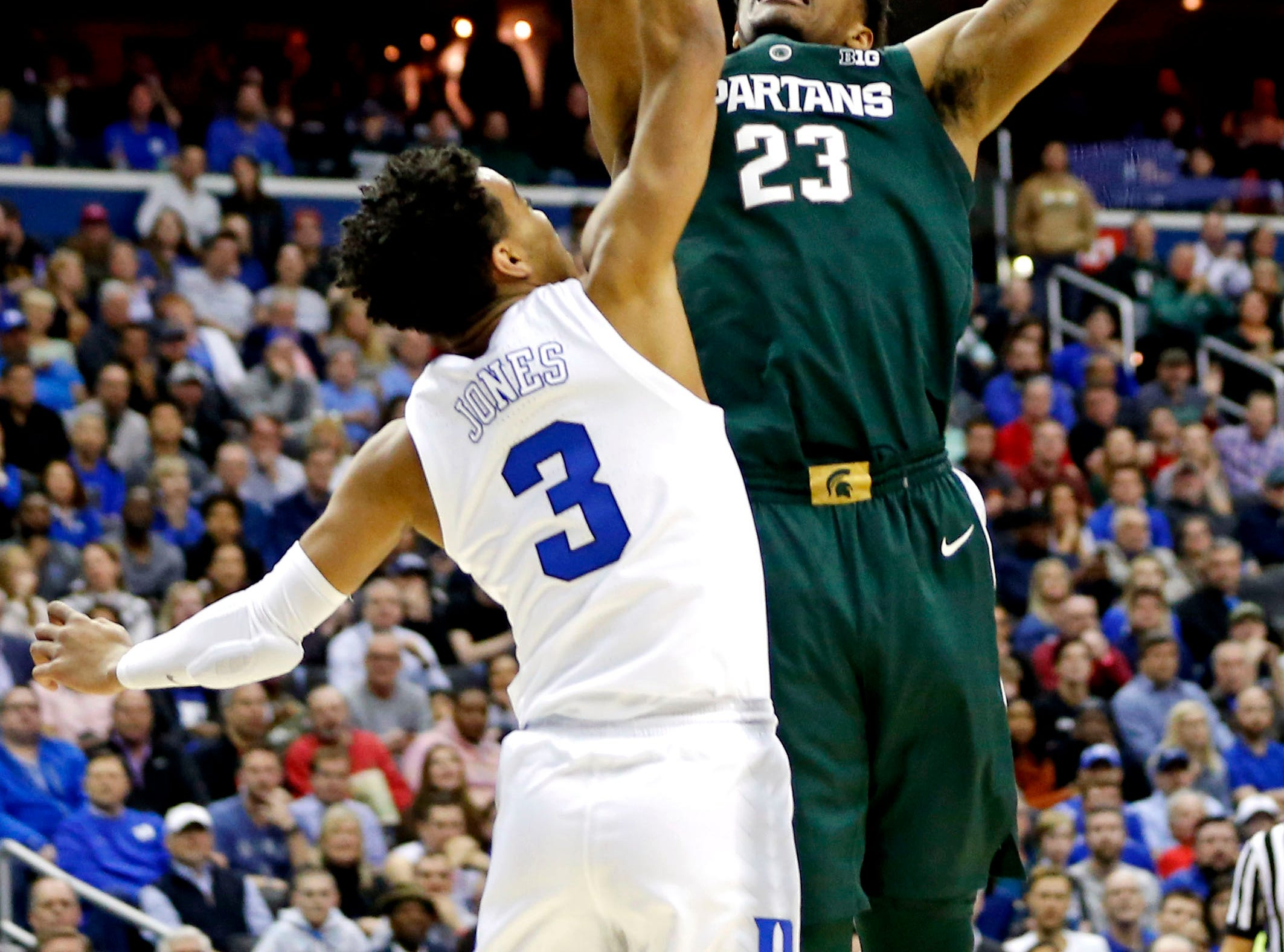 Mar 31, 2019; Washington, DC, USA; Michigan State Spartans forward Xavier Tillman (23) shoots the ball against Duke Blue Devils guard Tre Jones (3) during the first half in the championship game of the east regional of the 2019 NCAA Tournament at Capital One Arena. Mandatory Credit: Amber Searls-USA TODAY Sports