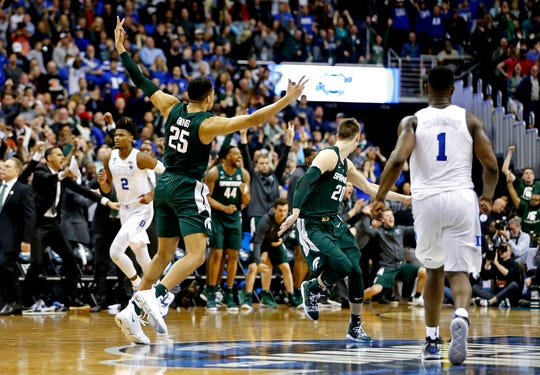 Michigan State Spartans forward Kenny Goins (25) reacts after the go-ahead three-pointer against the Duke Blue Devils in the championship game of the east regional of the 2019 NCAA Tournament at Capital One Arena, March 31, 2019.