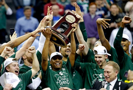 Michigan State Spartans guard Cassius Winston (5) and the Michigan State Spartans celebrating beating the Duke Blue Devils in the championship game of the east regional of the 2019 NCAA Tournament at Capital One Arena.
