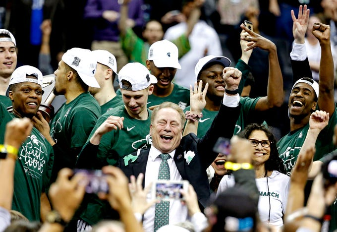 Mar 31, 2019; Washington, DC, USA; Michigan State Spartans head coach Tom Izzo and his team celebrate beating the Duke Blue Devils in the championship game of the east regional of the 2019 NCAA Tournament at Capital One Arena. Mandatory Credit: Amber Searls-USA TODAY Sports