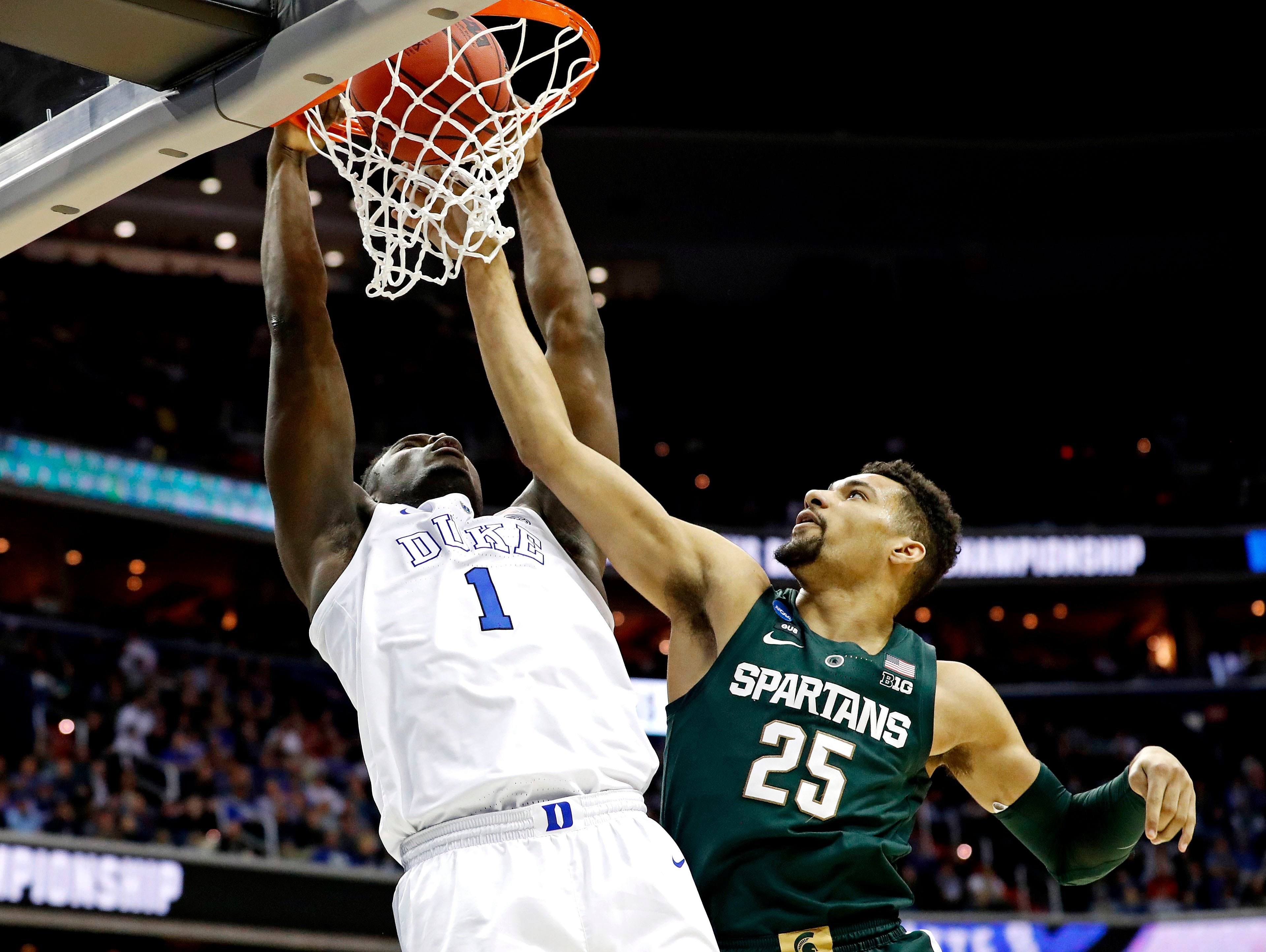 Mar 31, 2019; Washington, DC, USA; Duke Blue Devils forward Zion Williamson (1) dunks the ball against  in the championship game of the east regional of the 2019 NCAA Tournament at Capital One Arena. Mandatory Credit: Geoff Burke-USA TODAY Sports