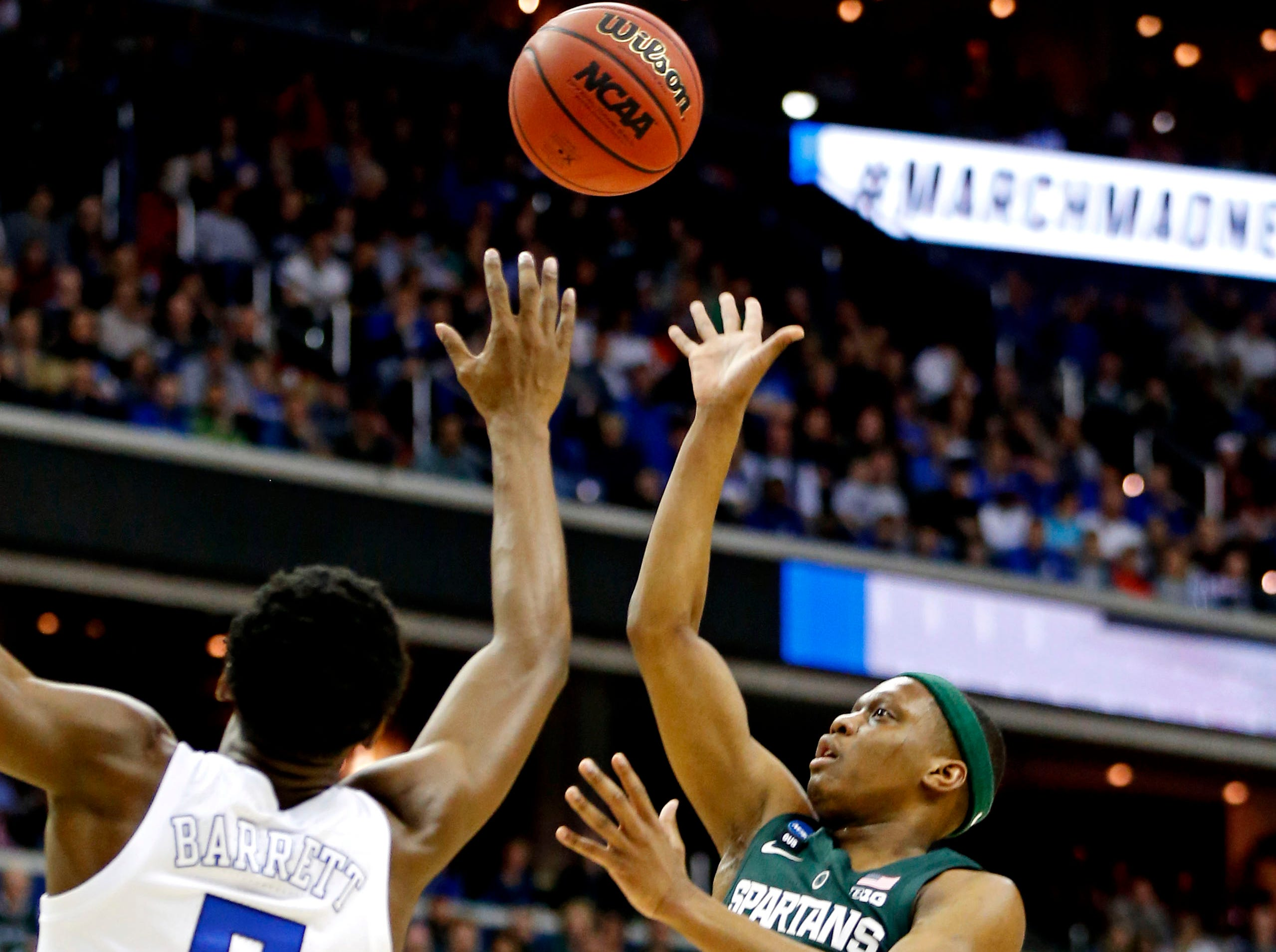 Mar 31, 2019; Washington, DC, USA; Michigan State Spartans guard Cassius Winston (5) shoots the ball against Duke Blue Devils forward RJ Barrett (5) during the first half in the championship game of the east regional of the 2019 NCAA Tournament at Capital One Arena. Mandatory Credit: Amber Searls-USA TODAY Sports
