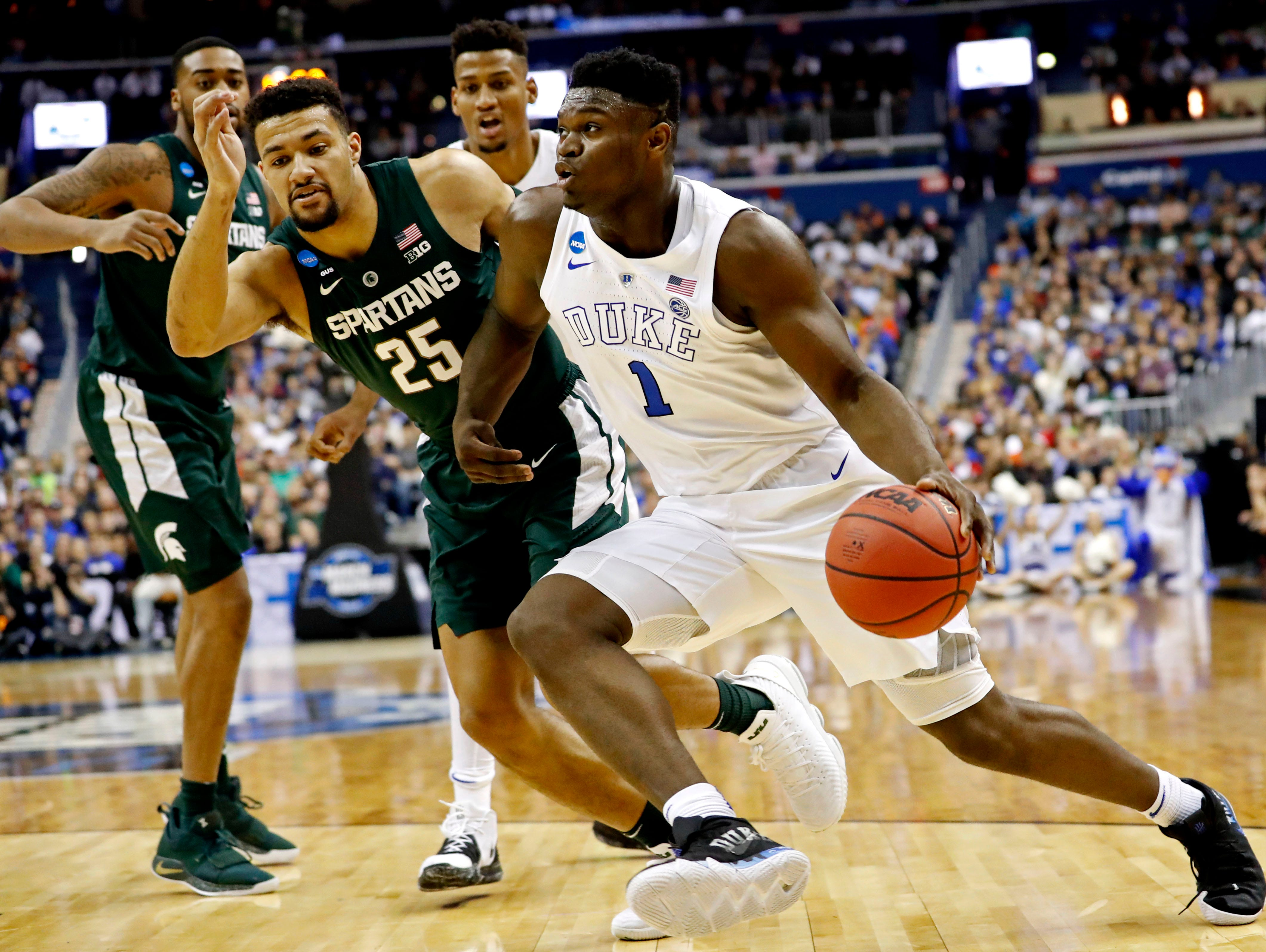 Mar 31, 2019; Washington, DC, USA; Duke Blue Devils forward Zion Williamson (1) drives to the basket against Michigan State Spartans forward Kenny Goins (25) during the first half in the championship game of the east regional of the 2019 NCAA Tournament at Capital One Arena. Mandatory Credit: Geoff Burke-USA TODAY Sports