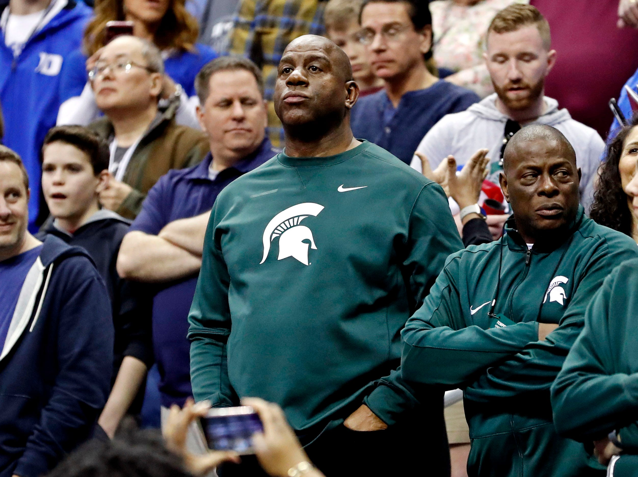 Mar 31, 2019; Washington, DC, USA; Michigan State Spartans former player Magic Johnson watches during the first half in the championship game of the east regional of the 2019 NCAA Tournament against the Duke Blue Devils at Capital One Arena. Mandatory Credit: Geoff Burke-USA TODAY Sports