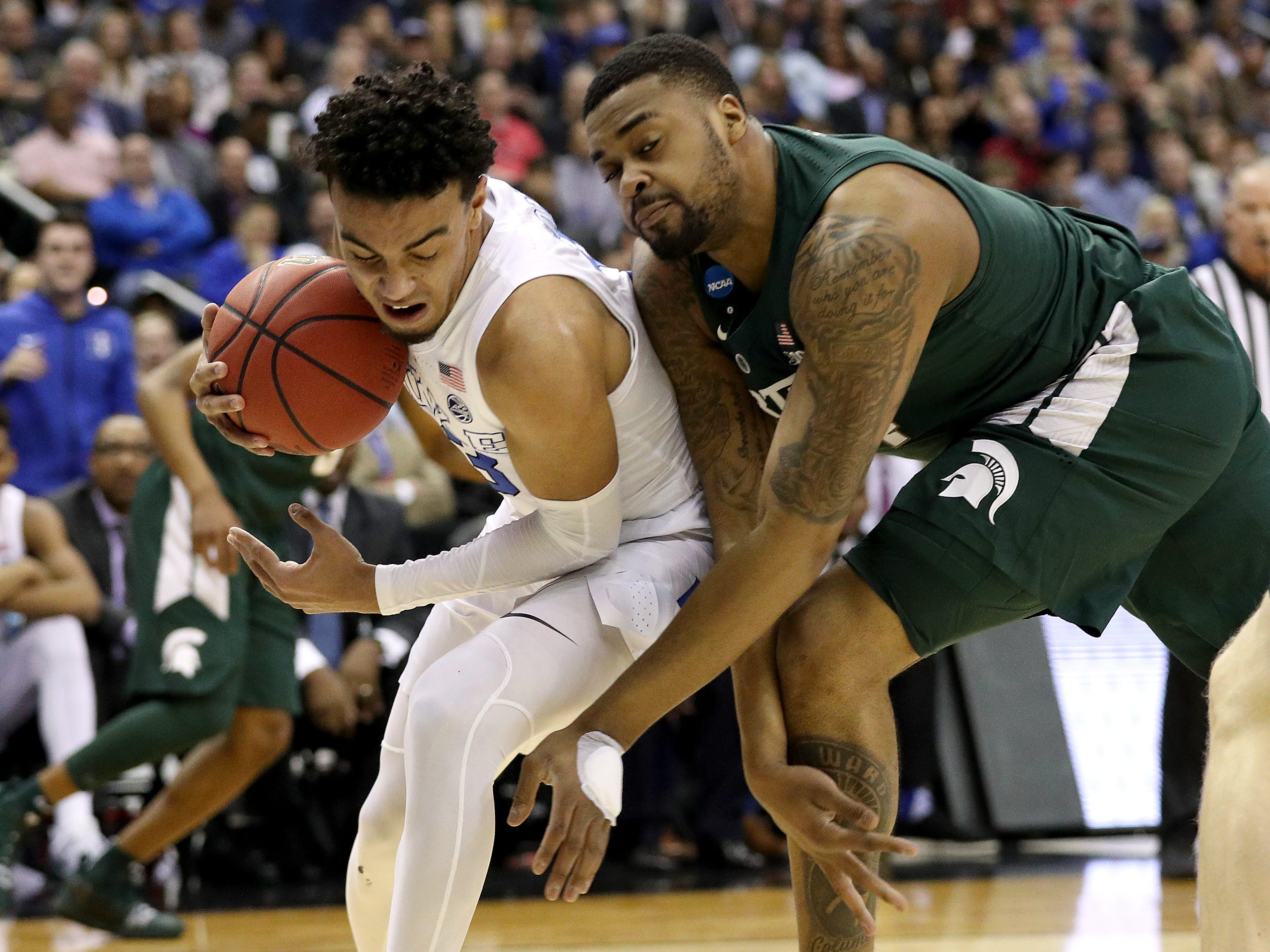 Tre Jones #3 of the Duke Blue Devils and Nick Ward #44 of the Michigan State Spartans battle for the ball during the first half in the East Regional game of the 2019 NCAA Men's Basketball Tournament at Capital One Arena on March 31, 2019 in Washington, DC.