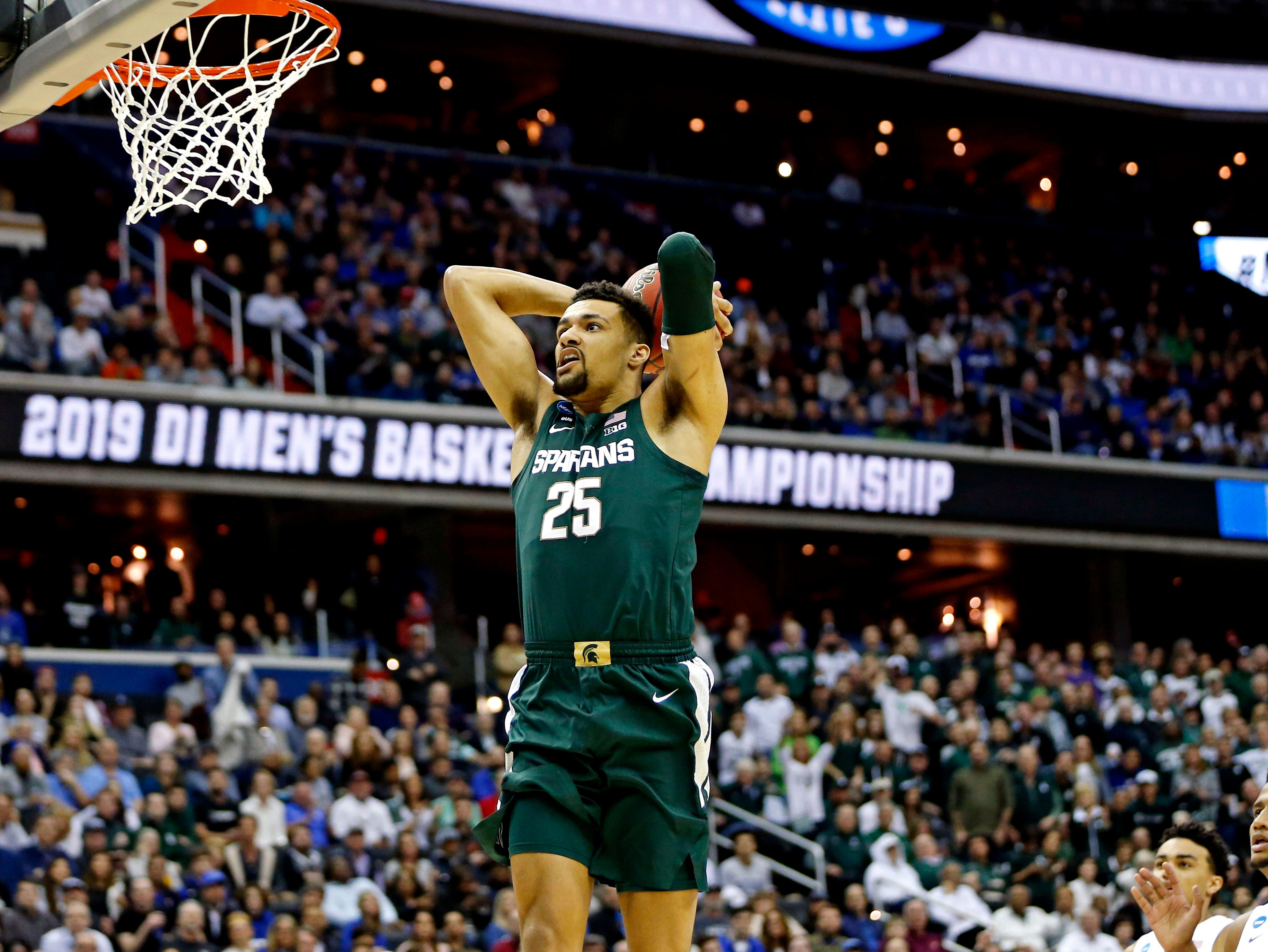 Michigan State Spartans forward Kenny Goins (25) dunks the ball during the first half against the Duke Blue Devils in the championship game of the east regional of the 2019 NCAA Tournament at Capital One Arena.