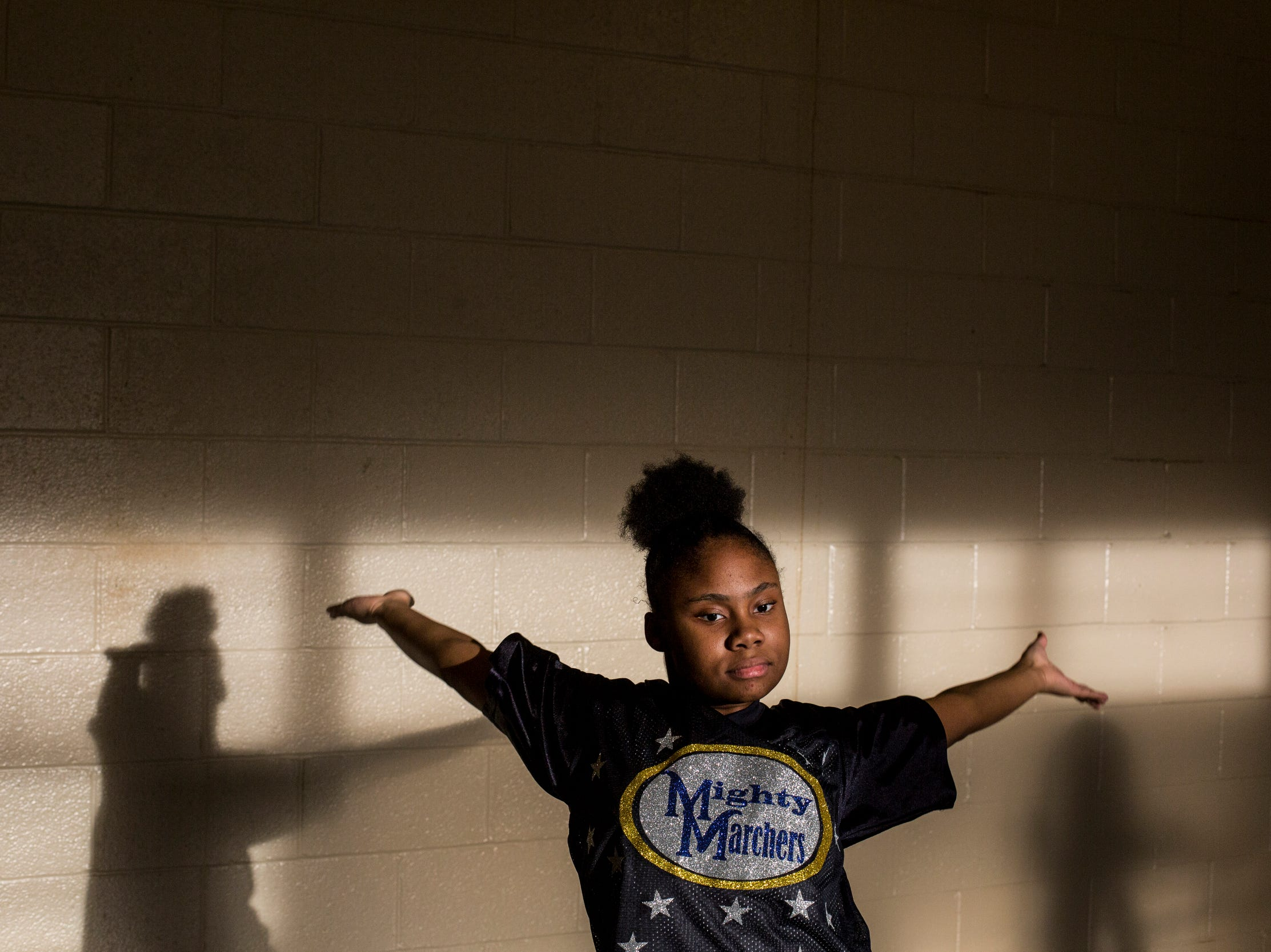 Angel Mitchell, 12, a member of the Memphis Community Youth Mighty Marchers, works on a dance move during a practice at the Ed Rice Community Center in Frayser on March 28, 2019.