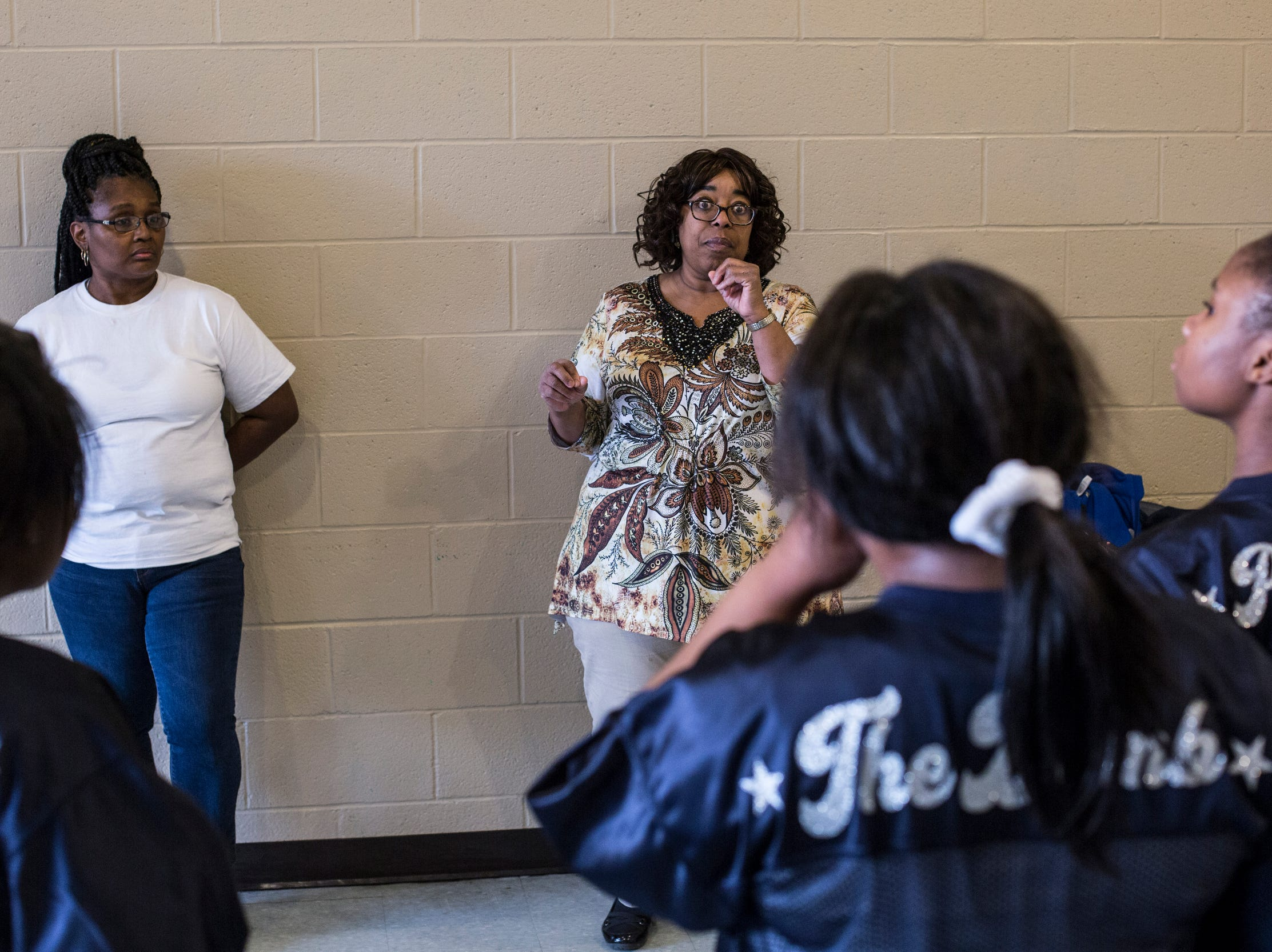 Sharon Cole, volunteer coach of the Memphis Community Youth Mighty Marchers Members, right, talks about a routine during a practice at the Ed Rice Community Center in Frayser on March 28, 2019.